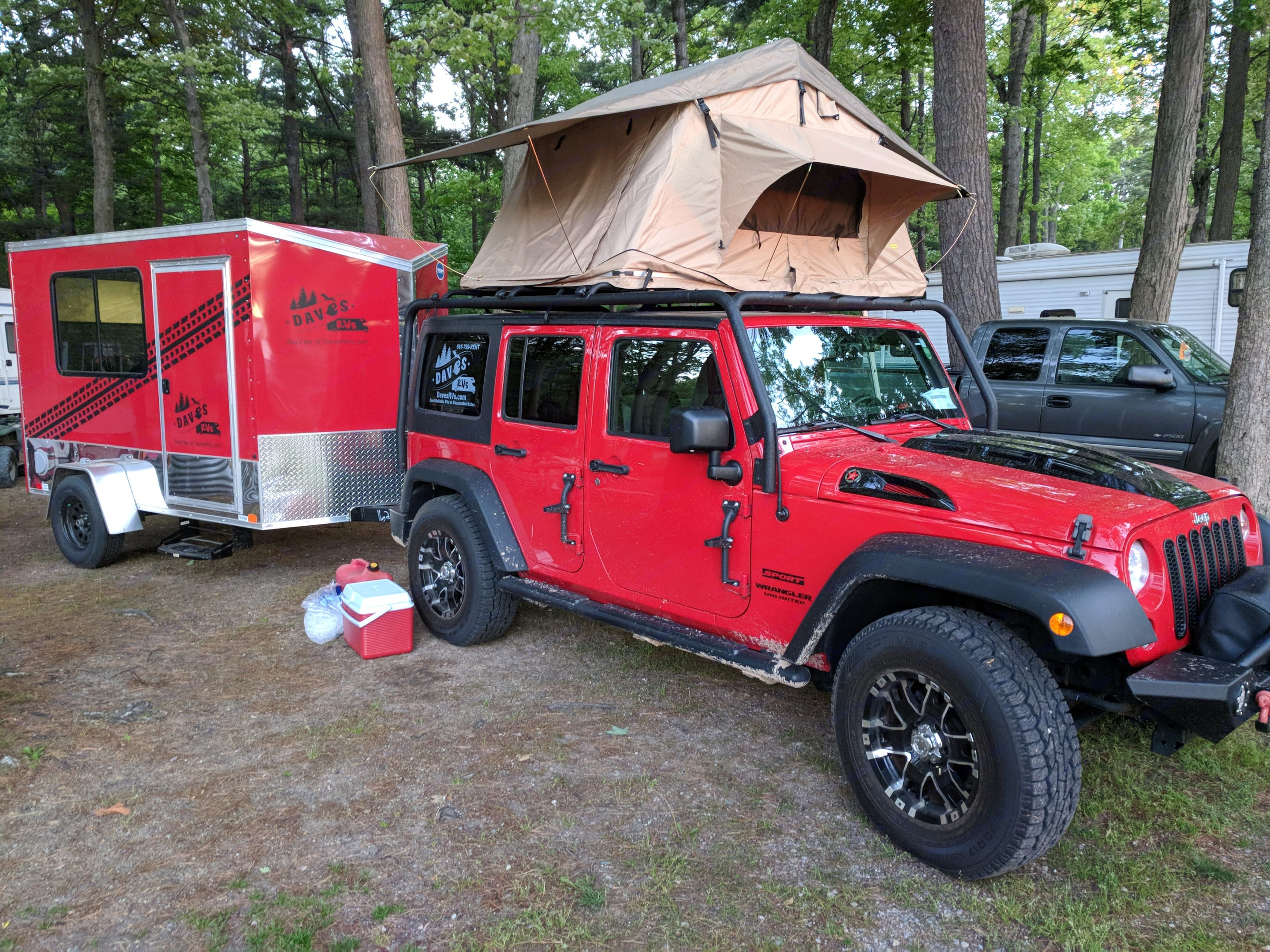 Red with Mobile Man Cave and Roof-top tent options. Jeep Wrangler - Sport 2014