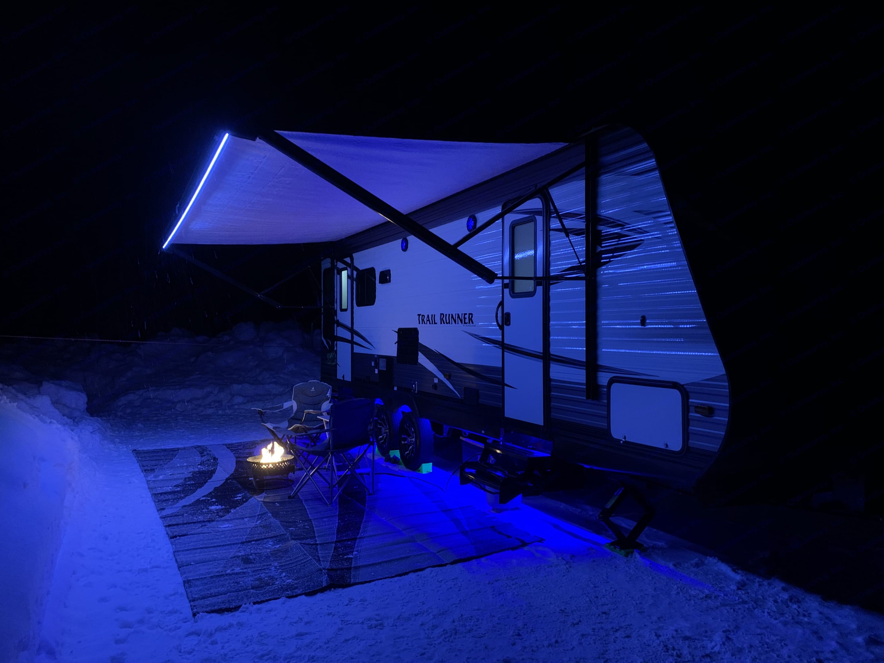 Features white LED lights along the awning and blue LED lights along the bottom of the trailer.. Heartland Trail Runner 2019