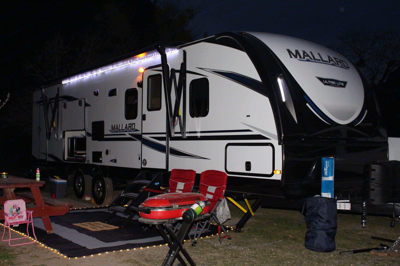 Great lighting for night entertainment. Side to side exterior storage.. Heartland Mallard 2020