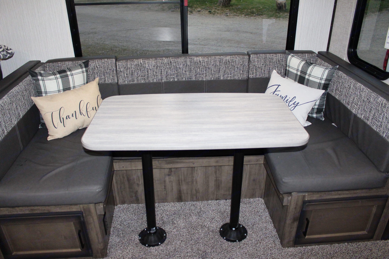 U - Shape dining table with plenty storage . Heartland Mallard 2020