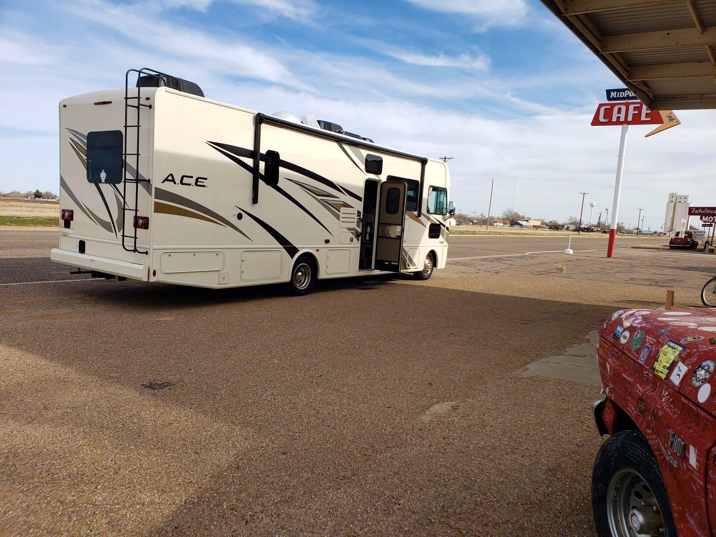 Back view, door open. Thor Motor Coach A.C.E 2020