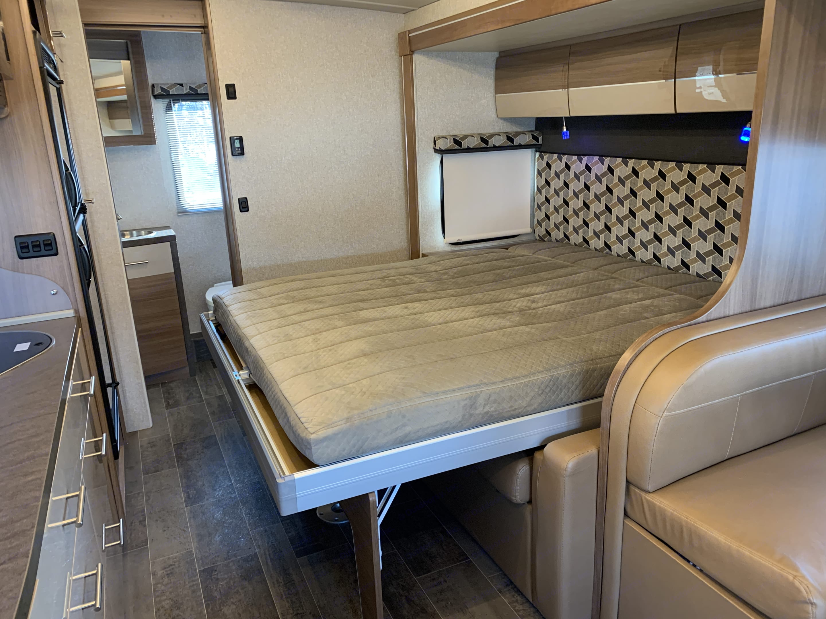 Murphy Bed that opens with the press of a button.. Winnebago View 2018