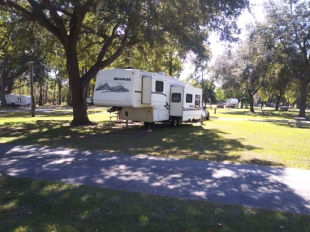 Camper while staying at Oak Plantation Campground on John's Island near Charleston, SC.. Keystone Montana 2000