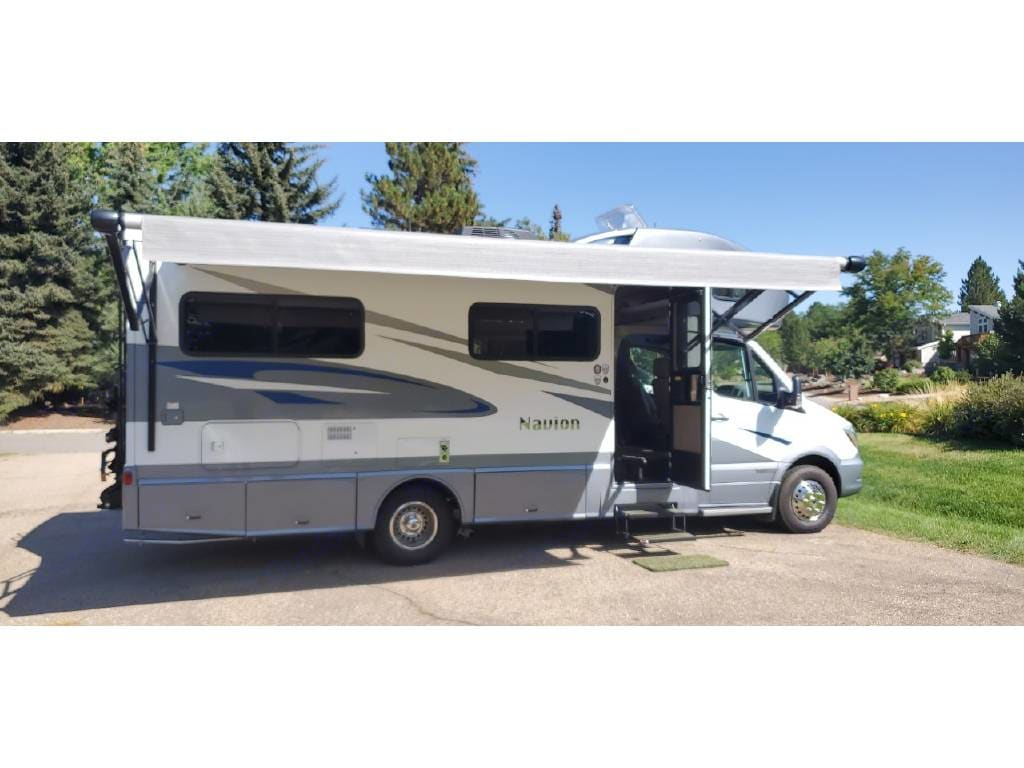 The automatic awning comes out at the push of a button and covers nearly the length of the RV.. Winnebago Mercedes Navion 2019