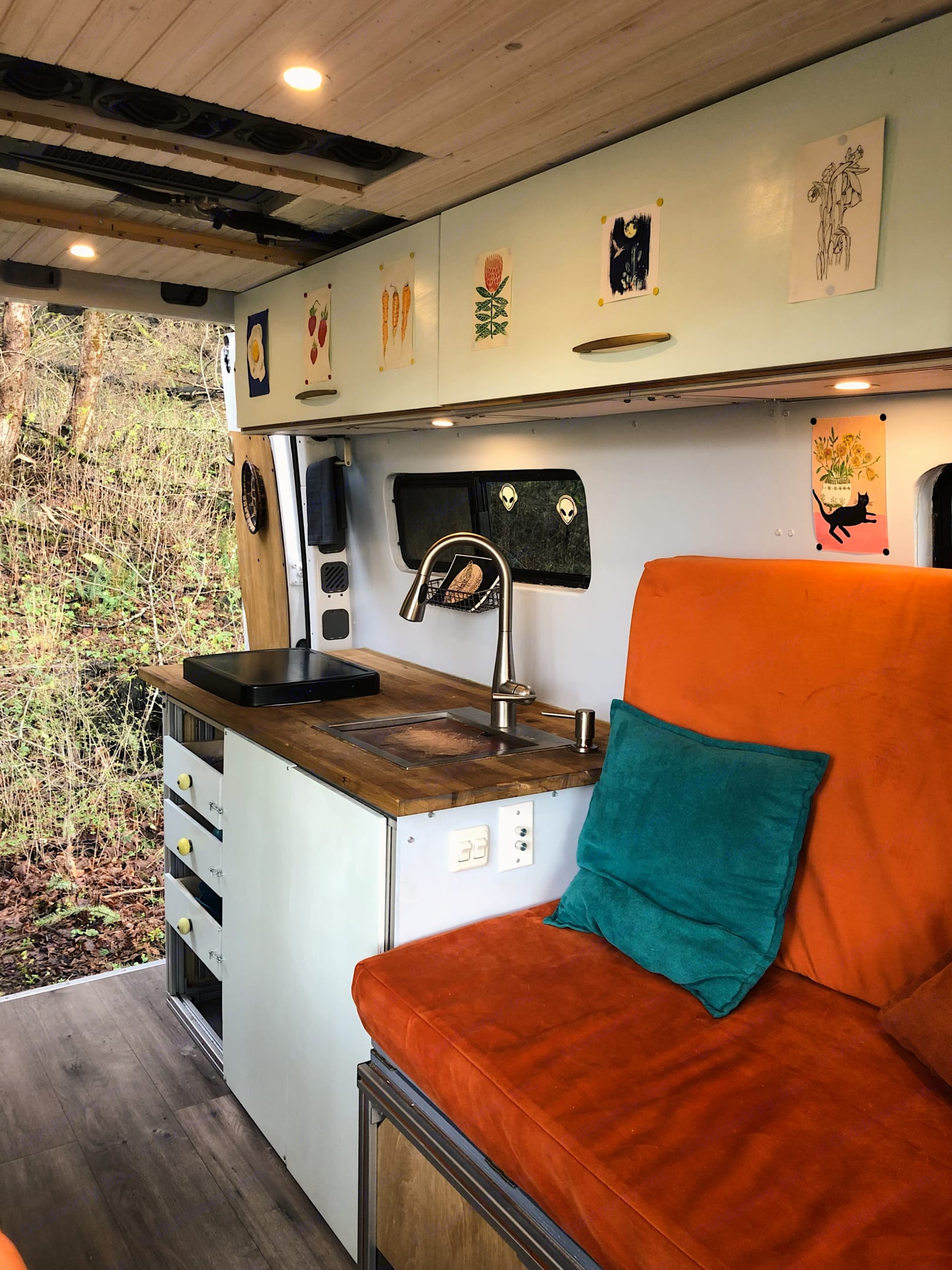 Just like at home, people will gather in the kitchen. Luckily the bed converts to a seating area so there is lots of space to hang.. Mercedes-Benz Sprinter 2012