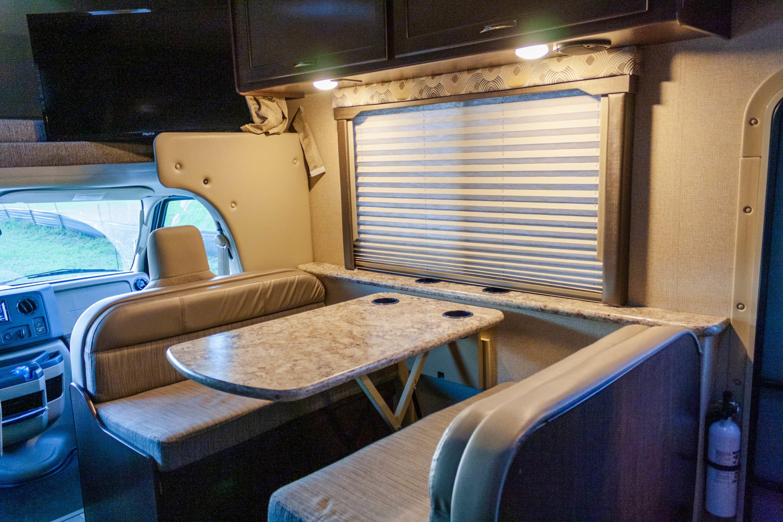 Comfortable dining area. Thor Motor Coach Freedom Elite 2019