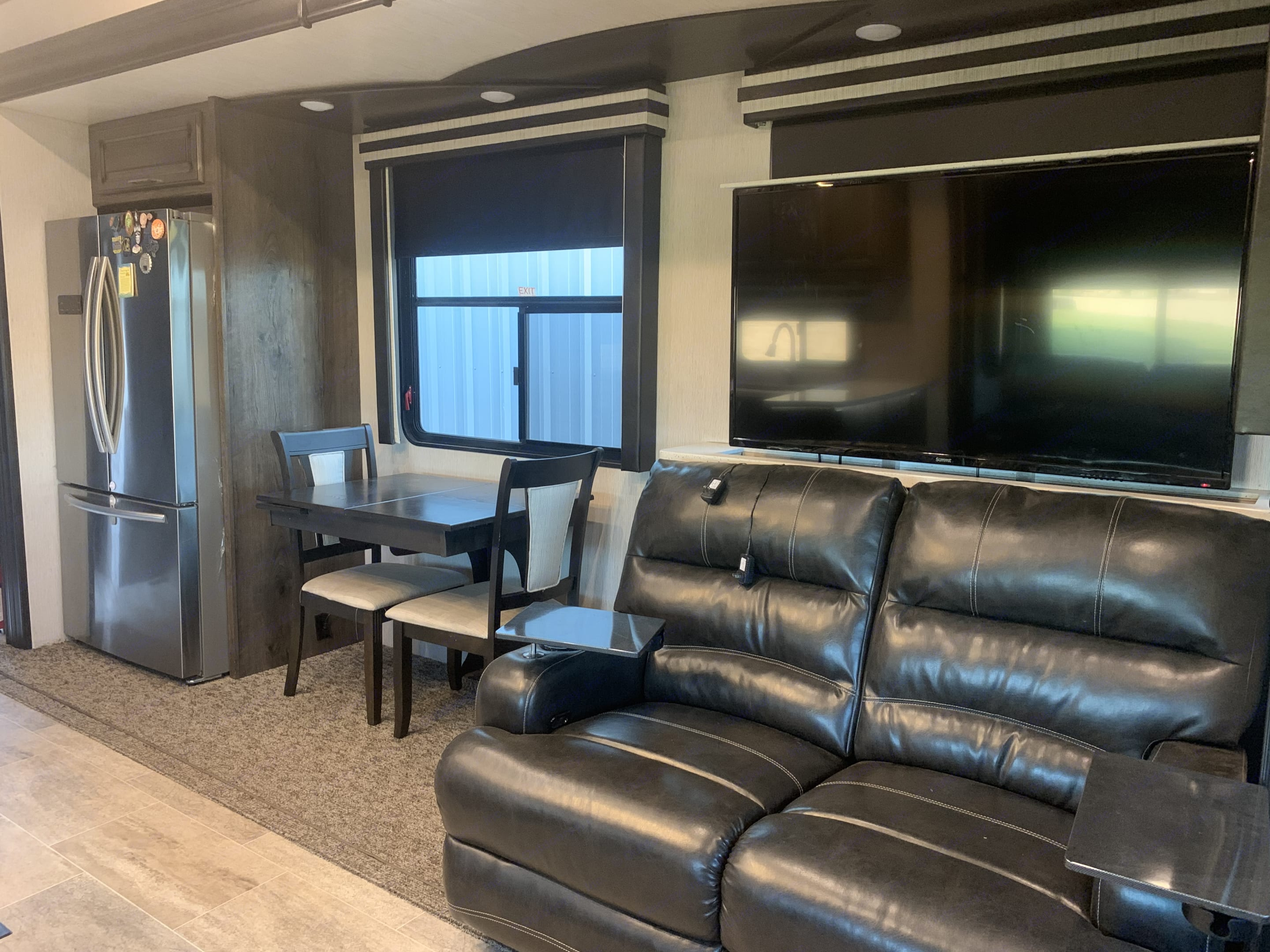 Full-size refrigerator. Kitchen table opens up to seat 4 people. Heartland Gateway 2017