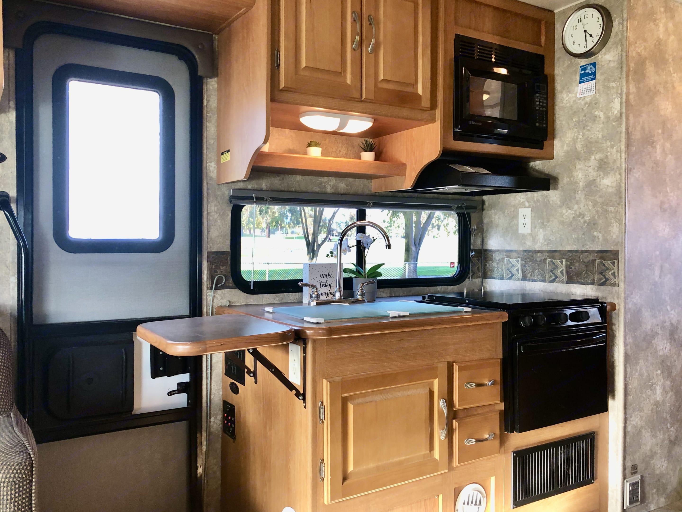 Extra work-space with counter extender, stove cover & glass sink-cover cutting boards  👍🏻. Coachmen Freelander 2007