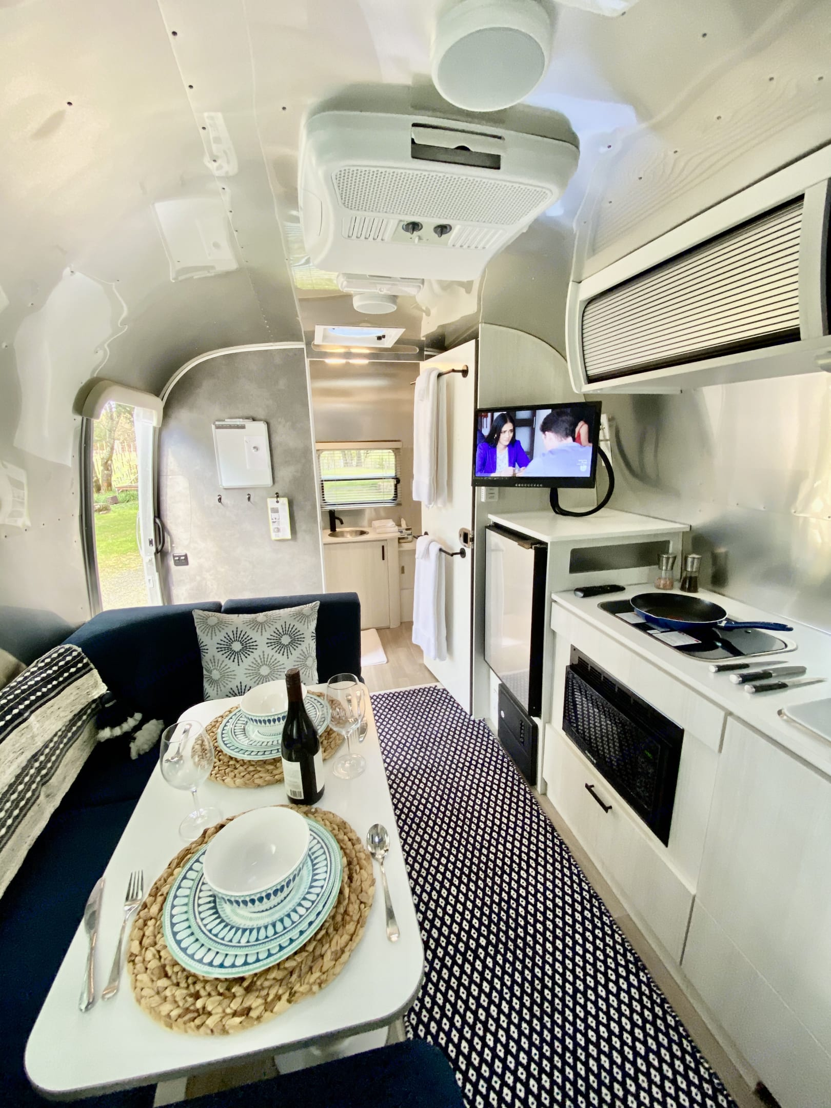 Plush carpeting, TV with DVD player and Roku, a Sonos Move Bluetooth speaker and more!. Airstream Bambi 2020