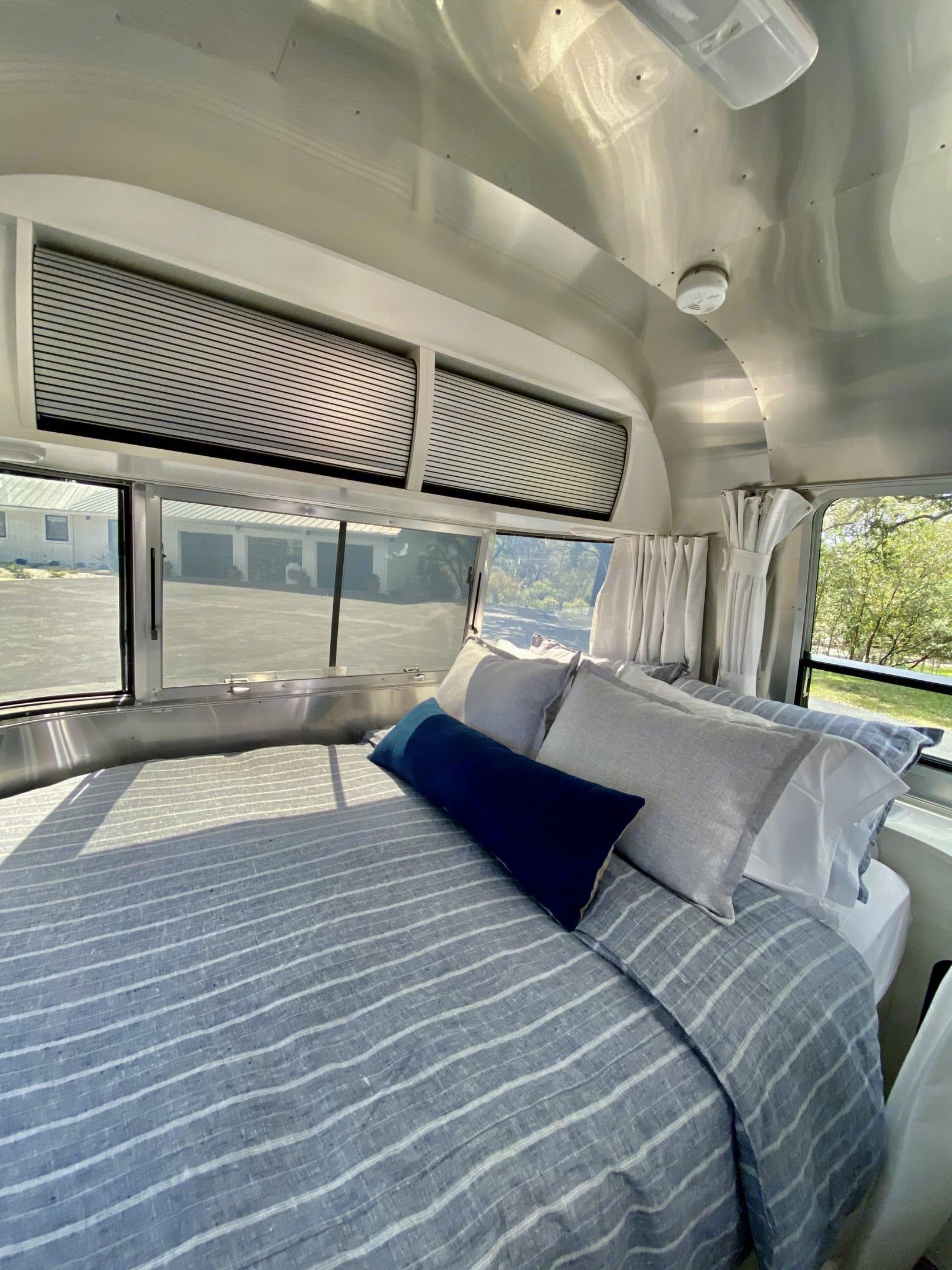 Restoration Hardware bed linens and duvet. Airstream Bambi 2020