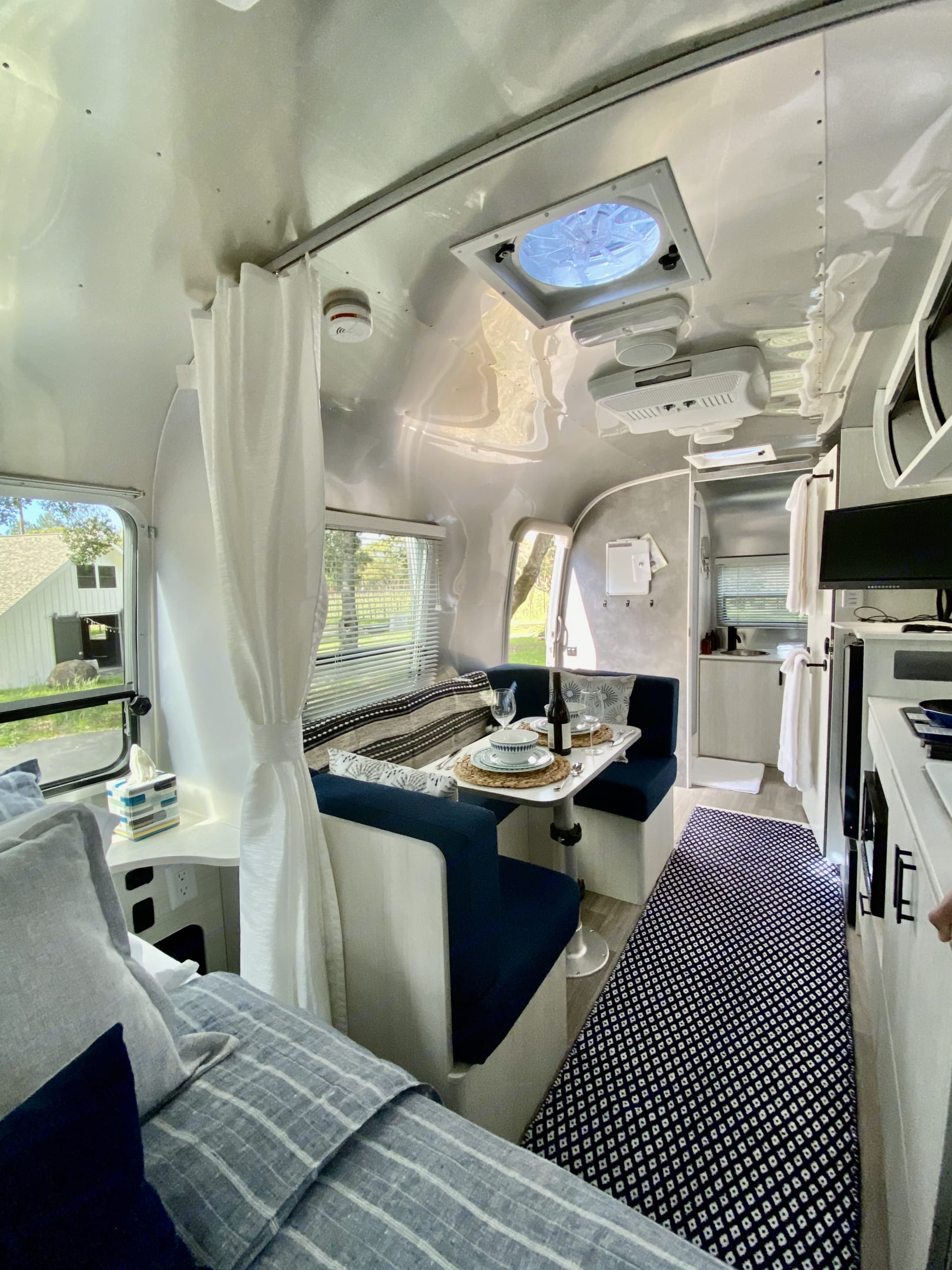 Dinette area for 4 converts to sleeping perfect for 2 small children. Airstream Bambi 2020