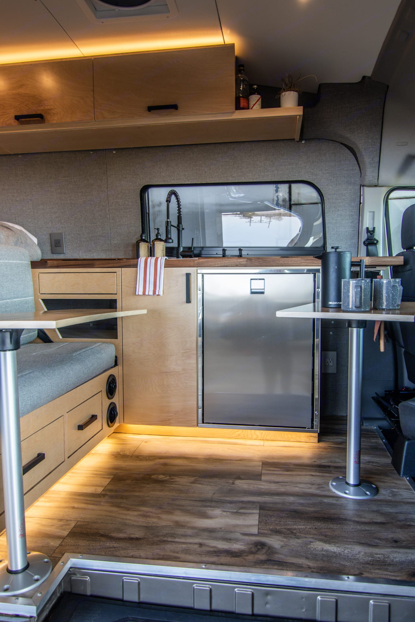 Two tables, sink, and fridge for maximum cocktail hour enjoyment. . Ford Transit 2020