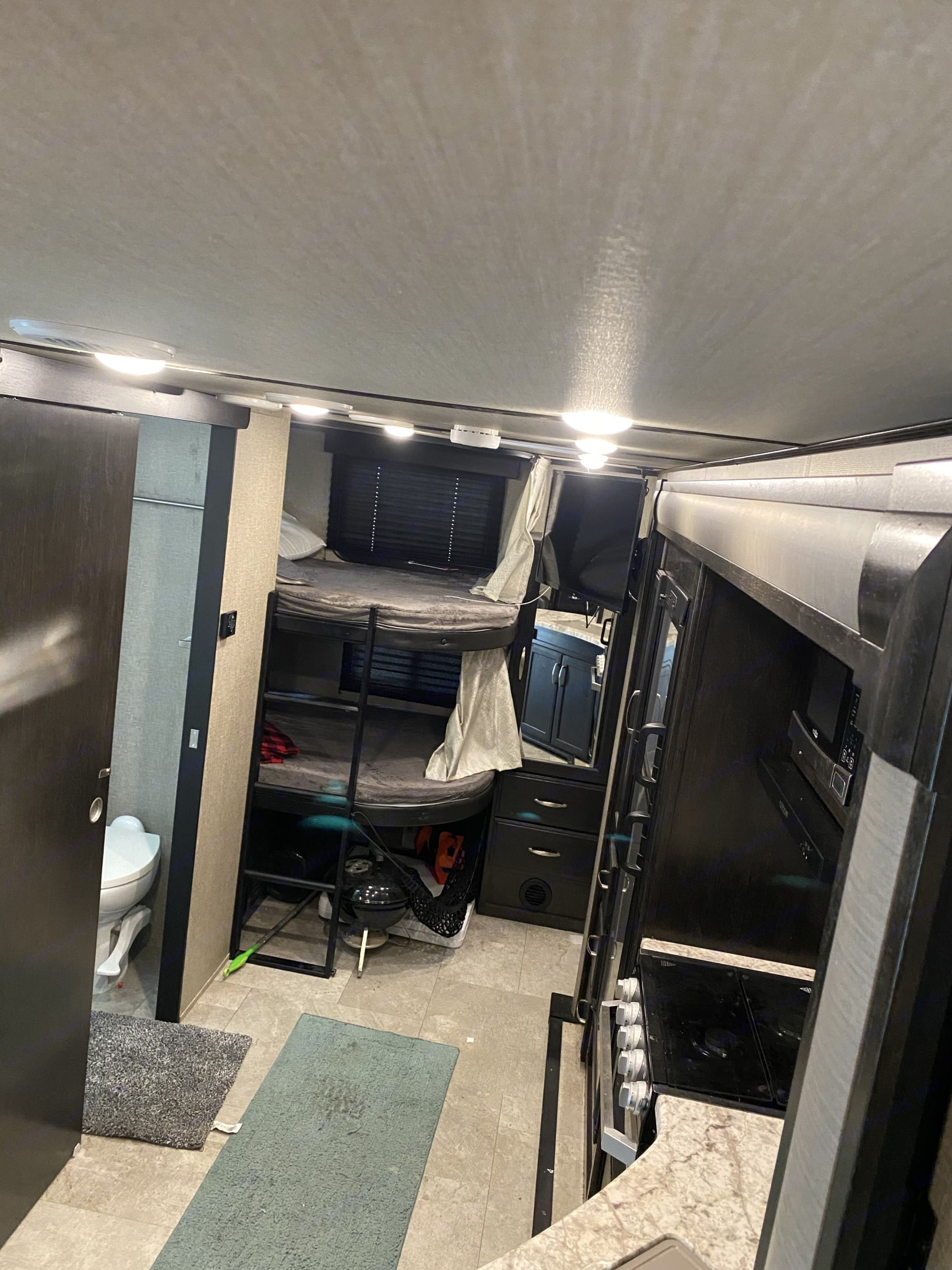 A/c in the camper operates via thermostat on the wall.A/c also comes through the ceiling ventilation system in the higher end models.. Grand Design Other 2020