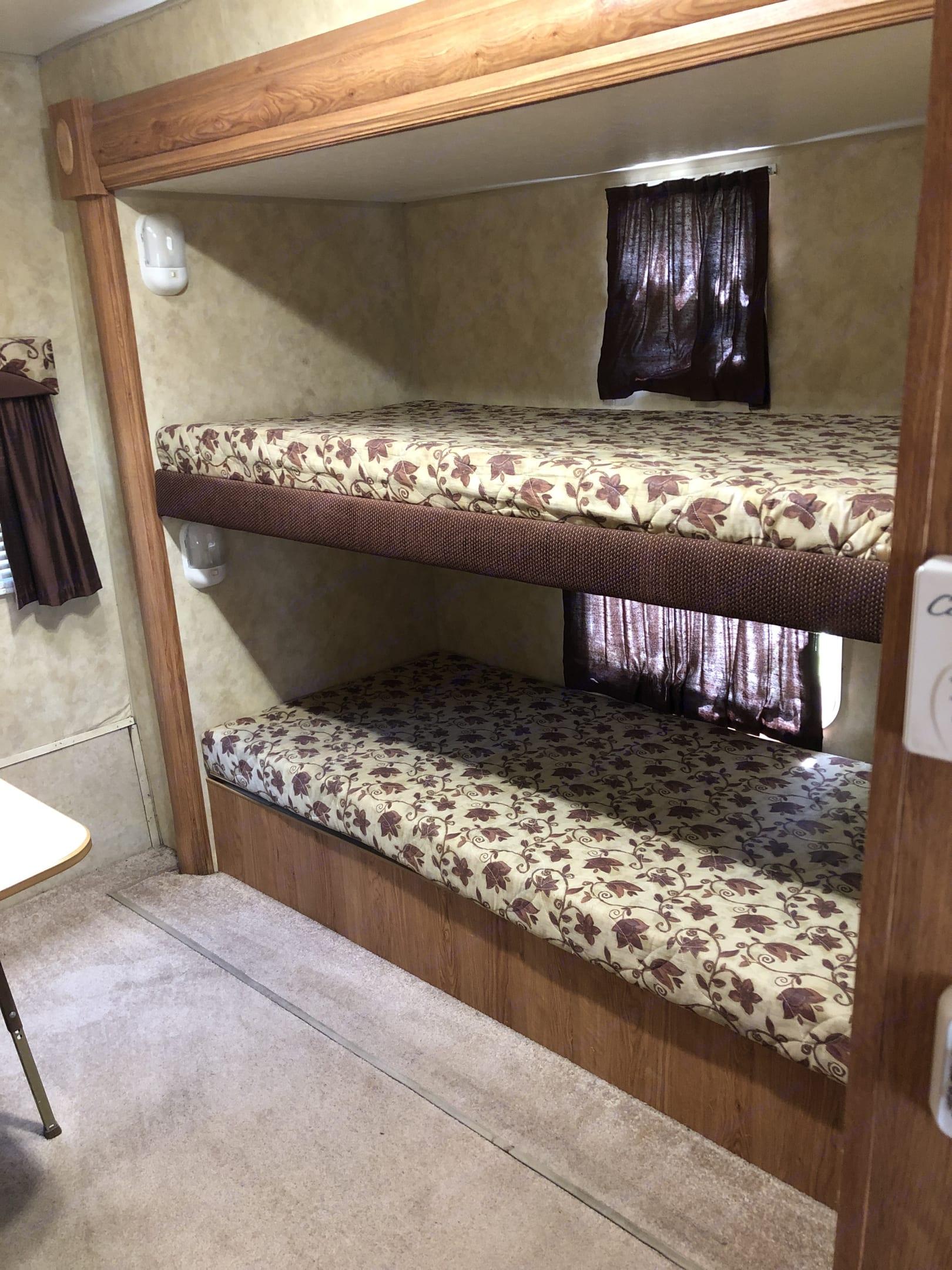Bunk beds in back slide. Jayco Flight 2008
