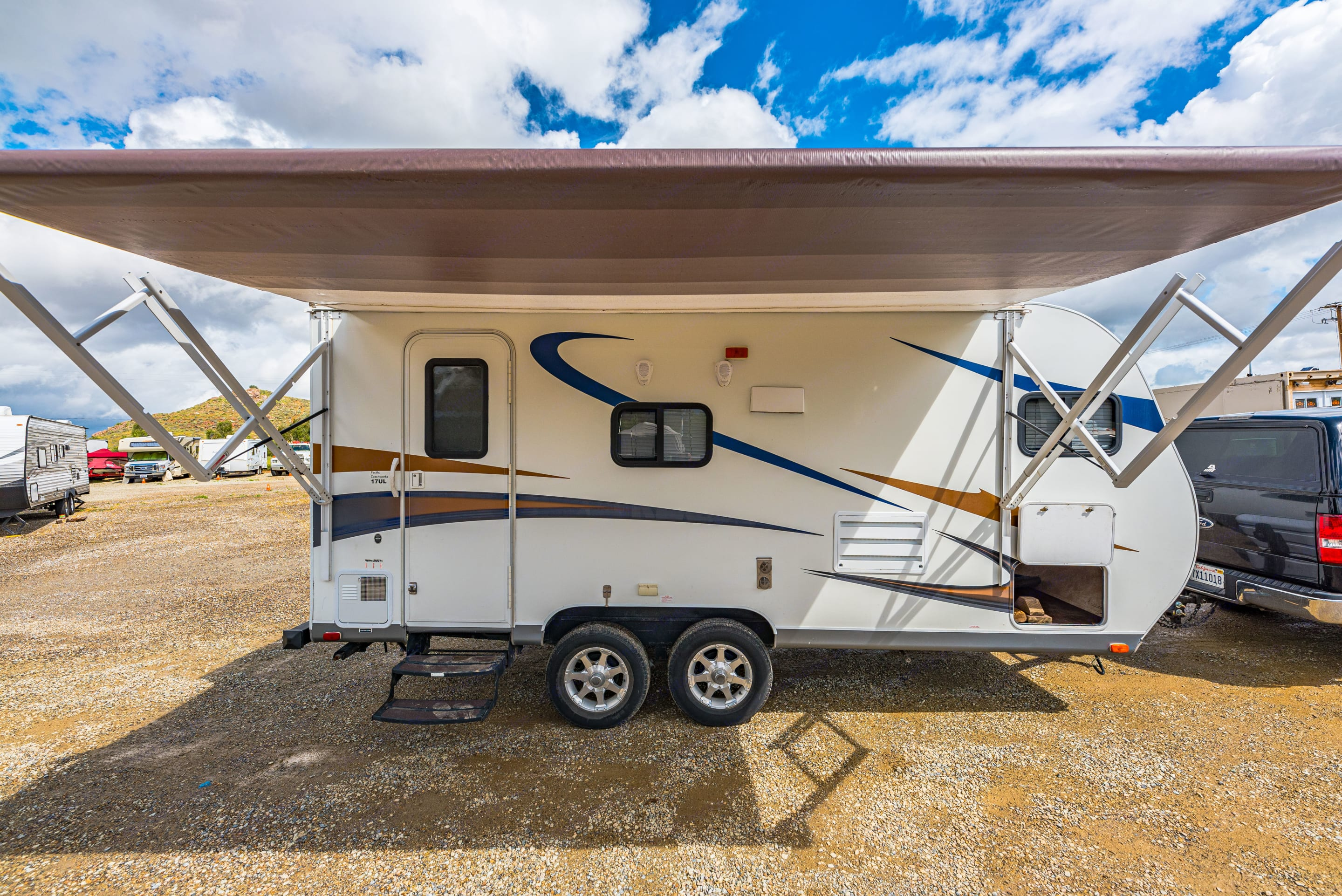 Awesome unit with an awning and slide. Pacific Coachworks Tango 2013