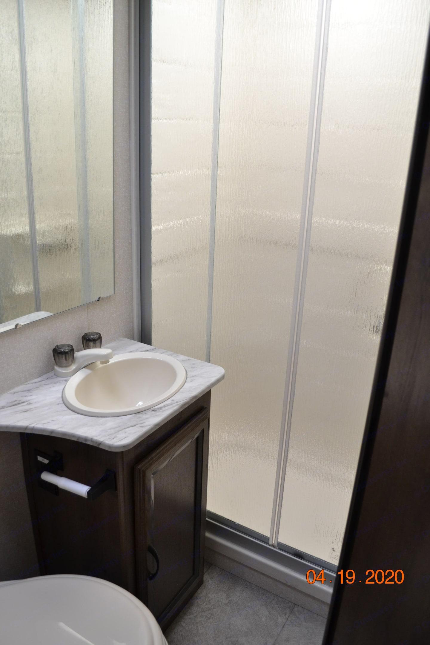 Bathroom with full shower. Coachmen Freelander 2019