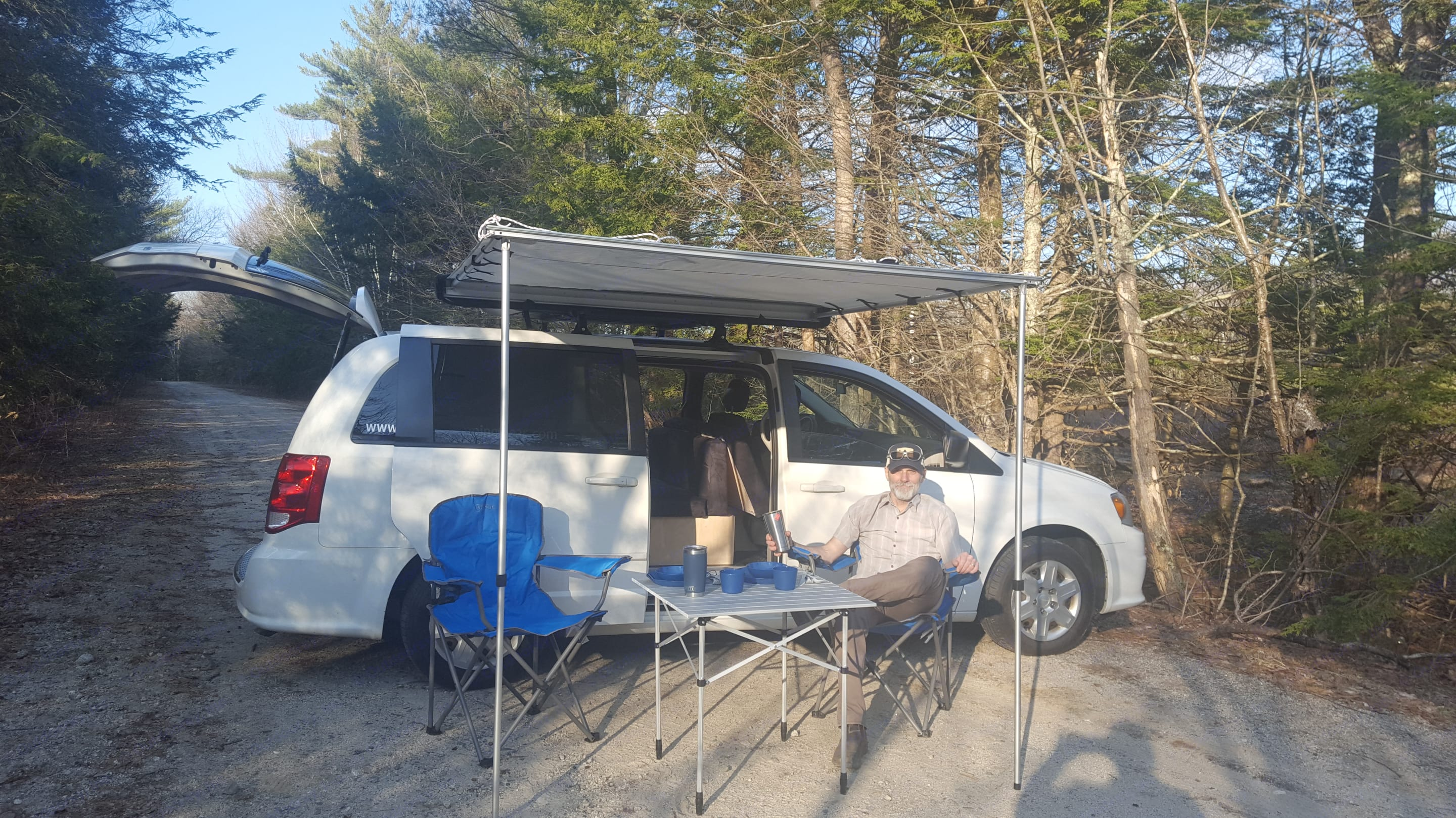 The van set up for breakfast, lunch, dinner or just relaxing at the campsite.. Dodge Caravan 2012