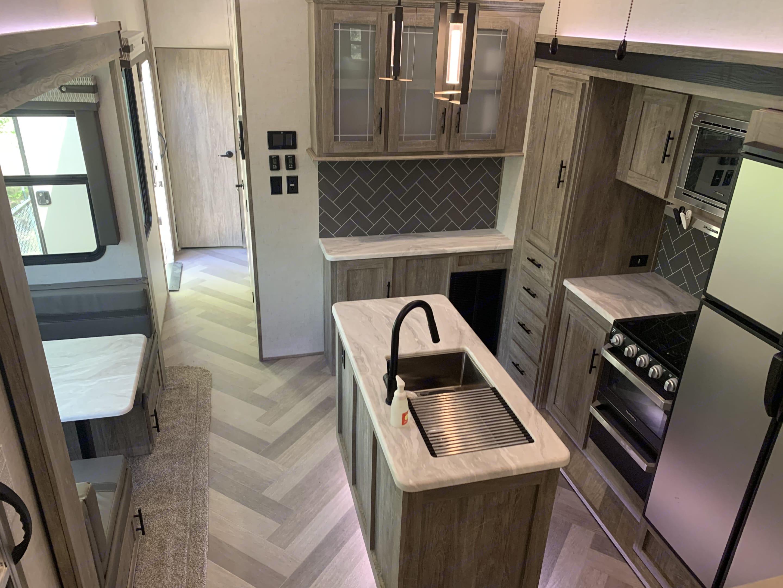 Kitchen fully stocked. Forest River Heritage Glen 2021