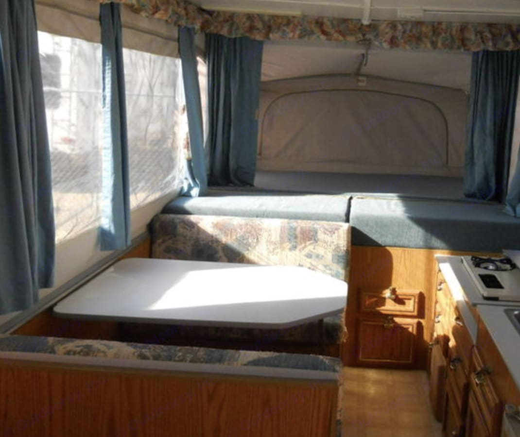 Dining area and king sized bed end. Jayco Designer 1995