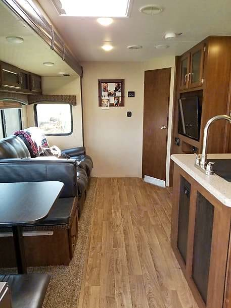 2 recliner chairs in front of the 40inch  tv and electric fireplace. Venture Sporttrek 237VIK bunkhouse 2017