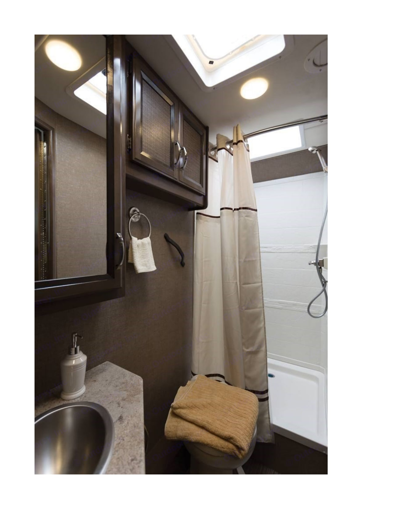 Bathroom, shower, toilet, sink, dressing area (double doors open into aisle, hallway, private area with access to wardrobe closet) NEAT!. Thor Motor Coach Axis 2017