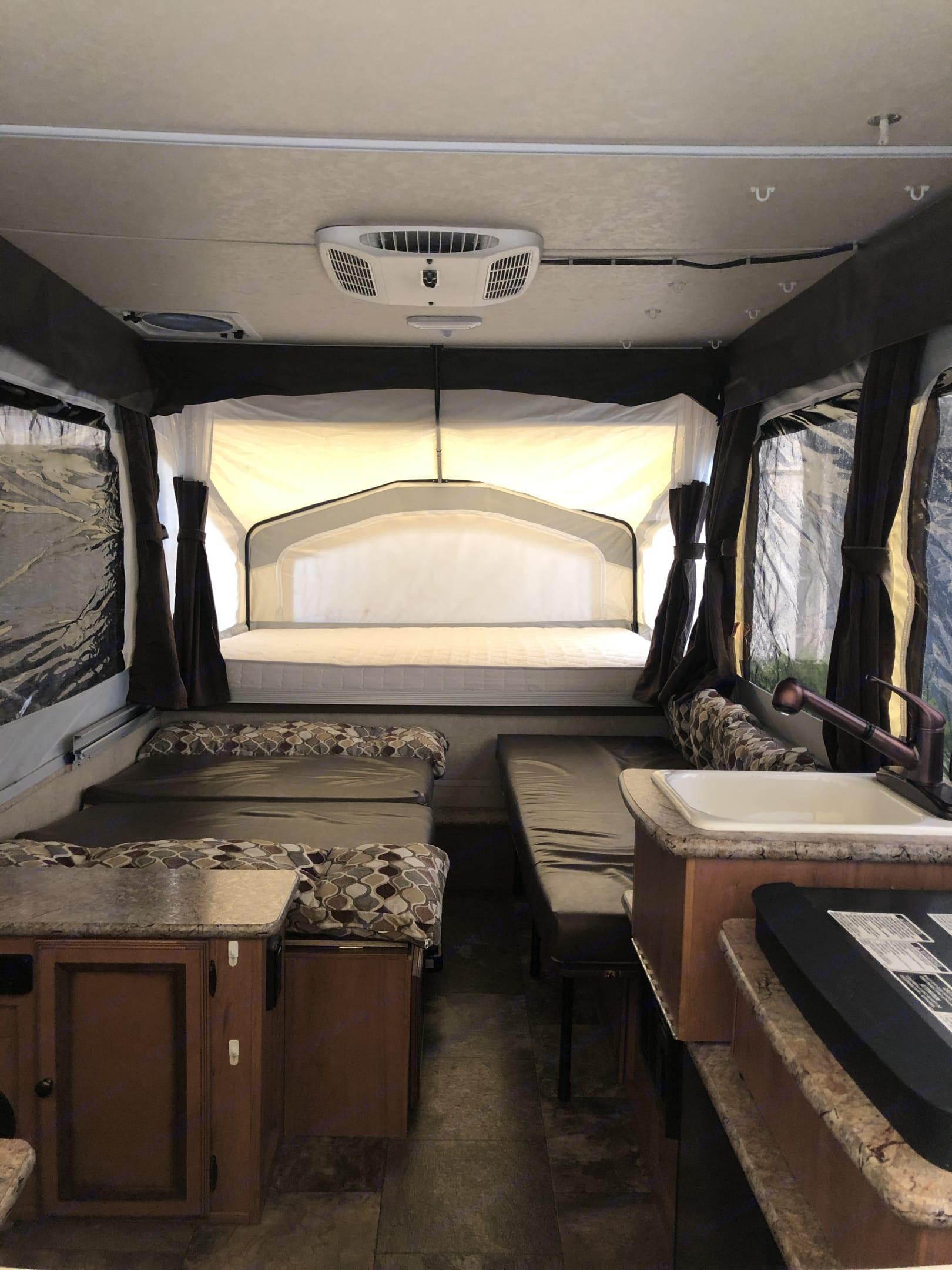Full size bed, sleeps 2. Palomino Base Camp 2016