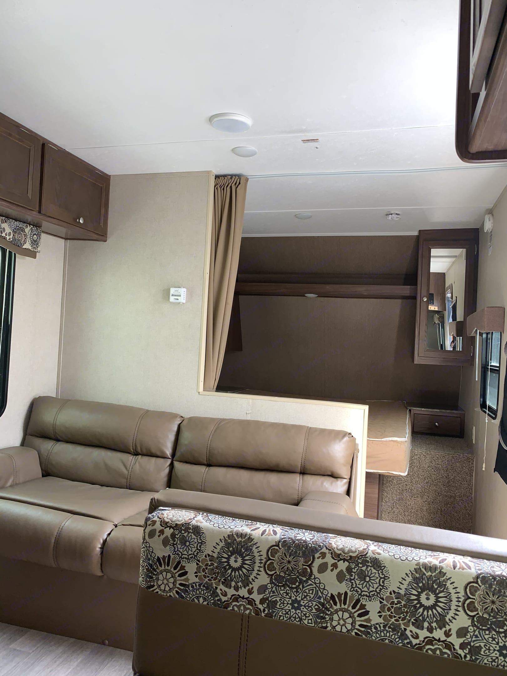 Convertible couch bed and queen sized bed are separated by a privacy curtain!. Dutchmen Coleman 2018