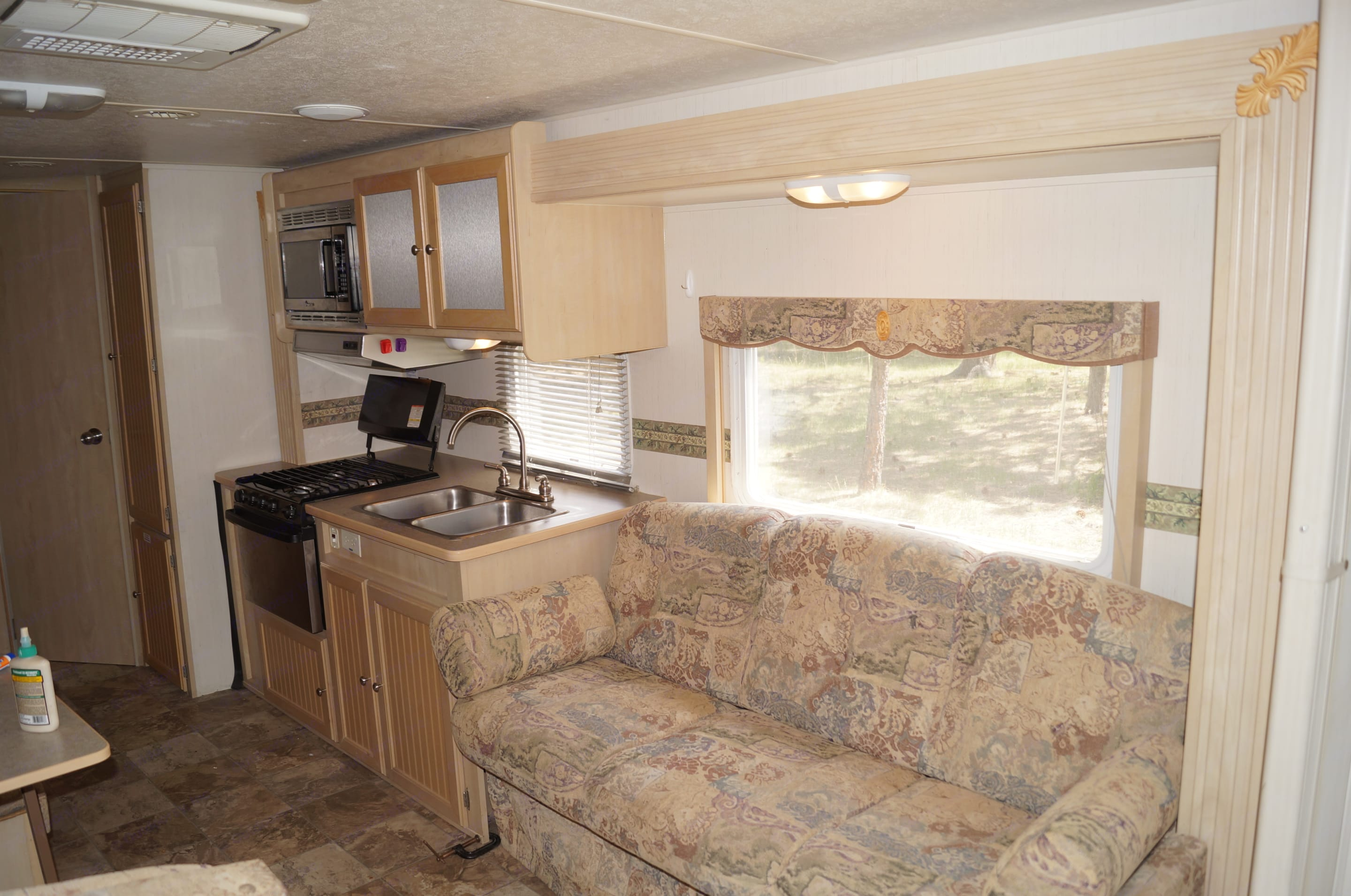 Couch folds down for sleeping. Forest River Grand Surveyor 2004