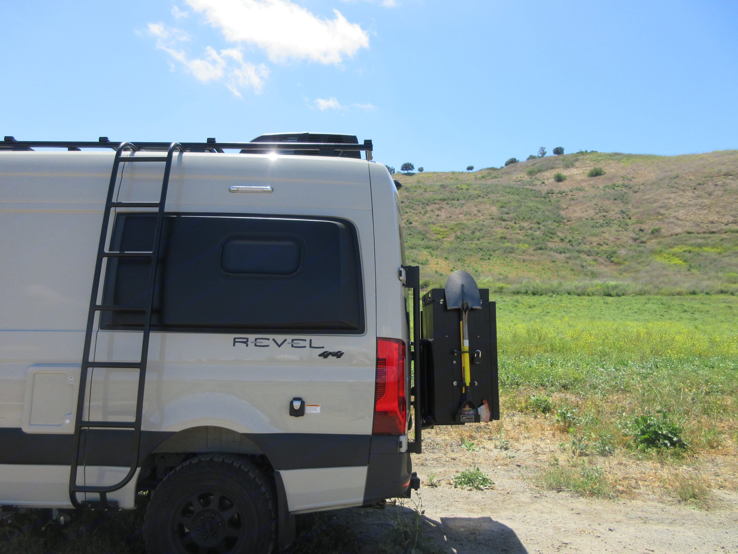 Rear showing Ladder and 2 boxes w/ Expedition Kit (Shovel / Axe Pack). Winnebago Revel 2020