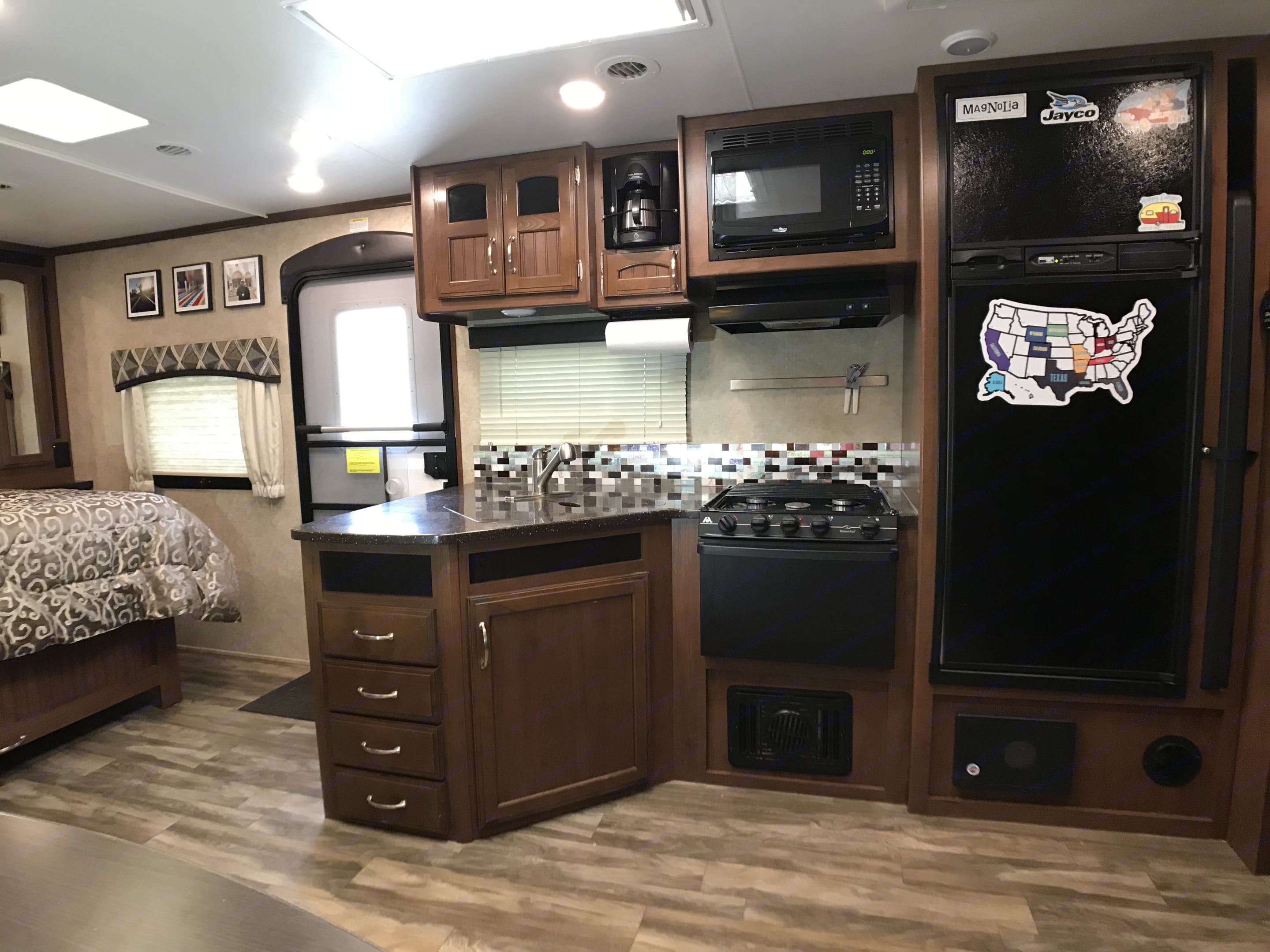 Kitchen and living area are very open. Jayco White Hawk 2017