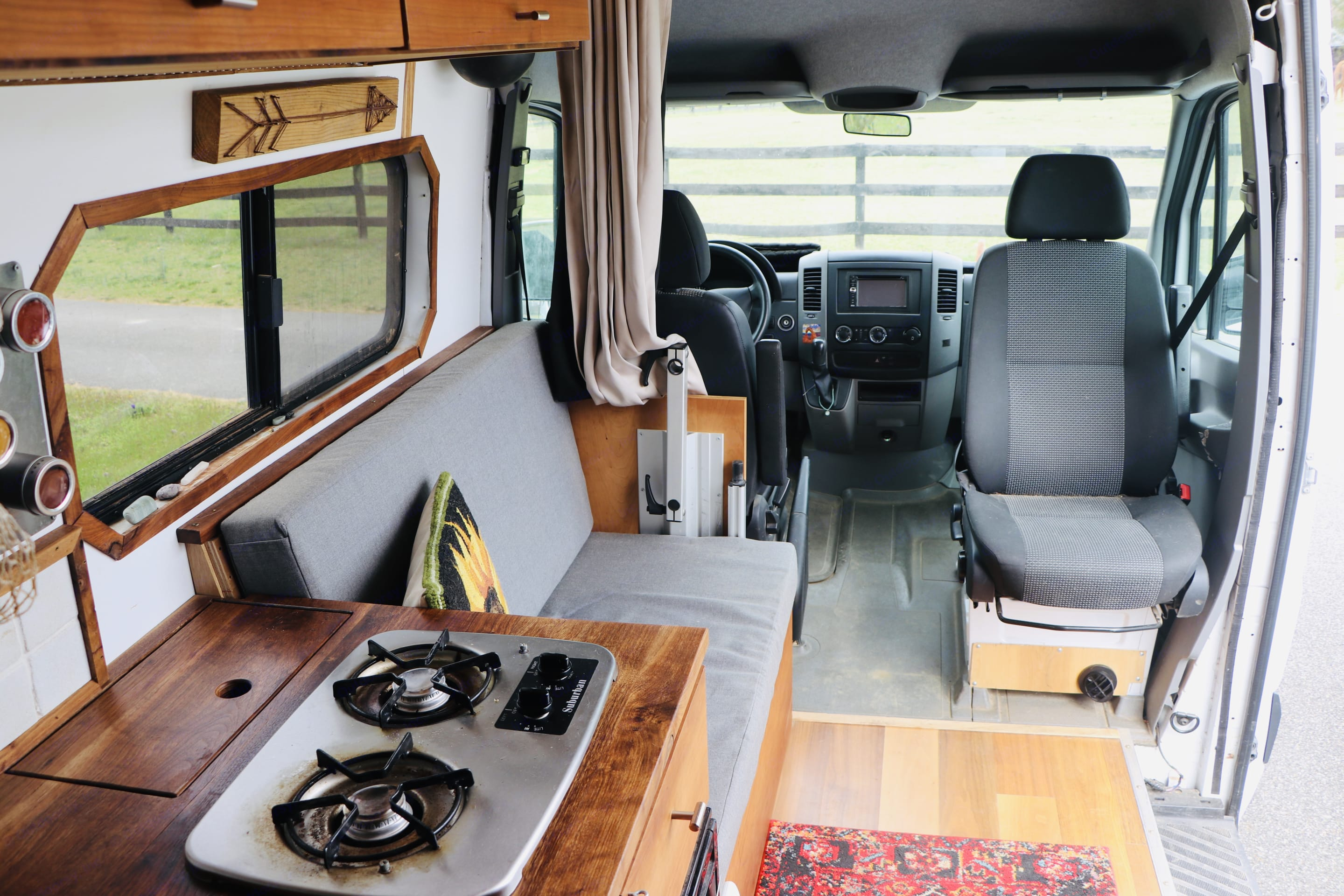 View from the bed, 2 burner propane stovetop, passenger swivel seat. Mercedes-Benz Sprinter 2013