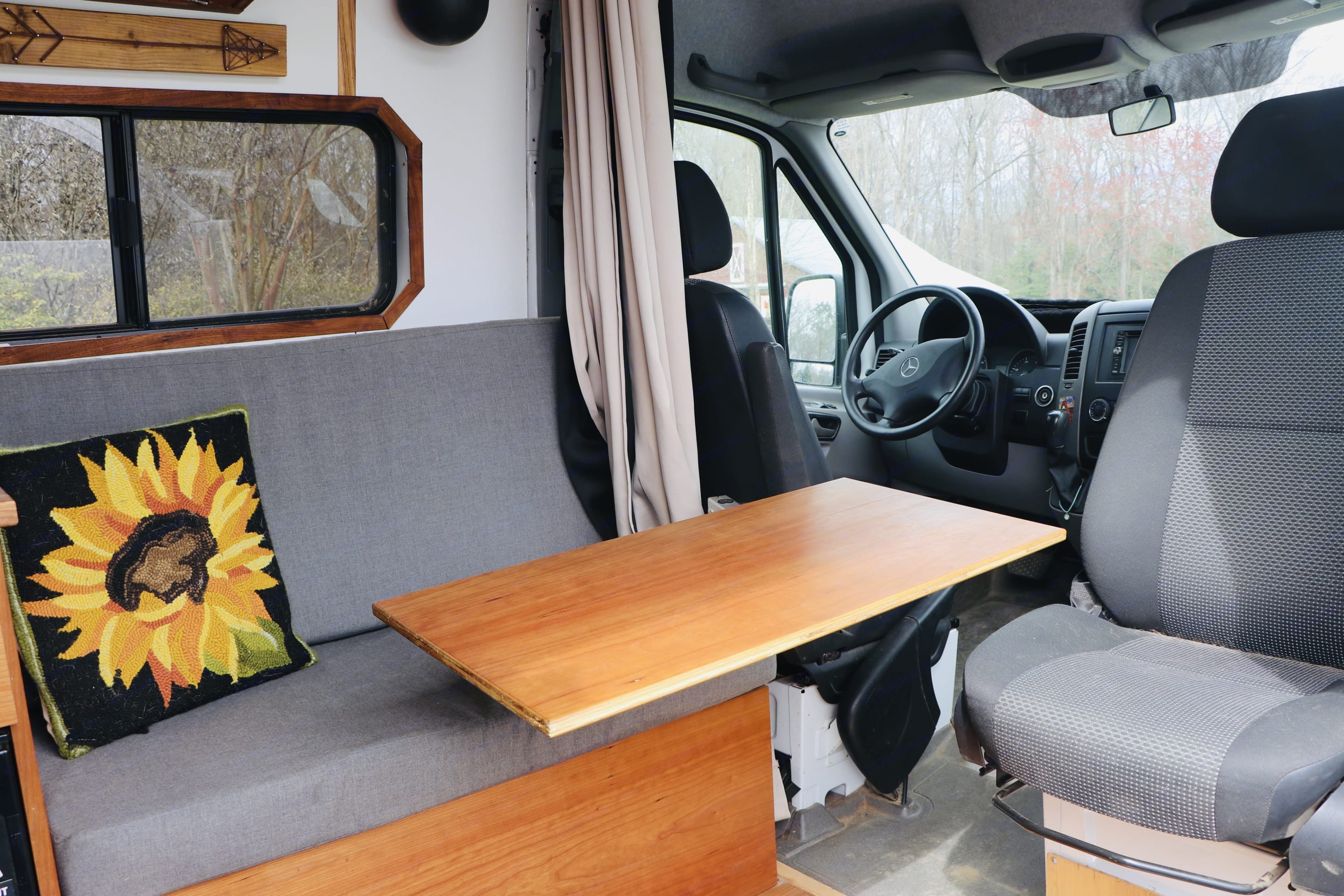 Removable table for dining, working, etc., sitting area accomodates 2-3 adults. Mercedes-Benz Sprinter 2013