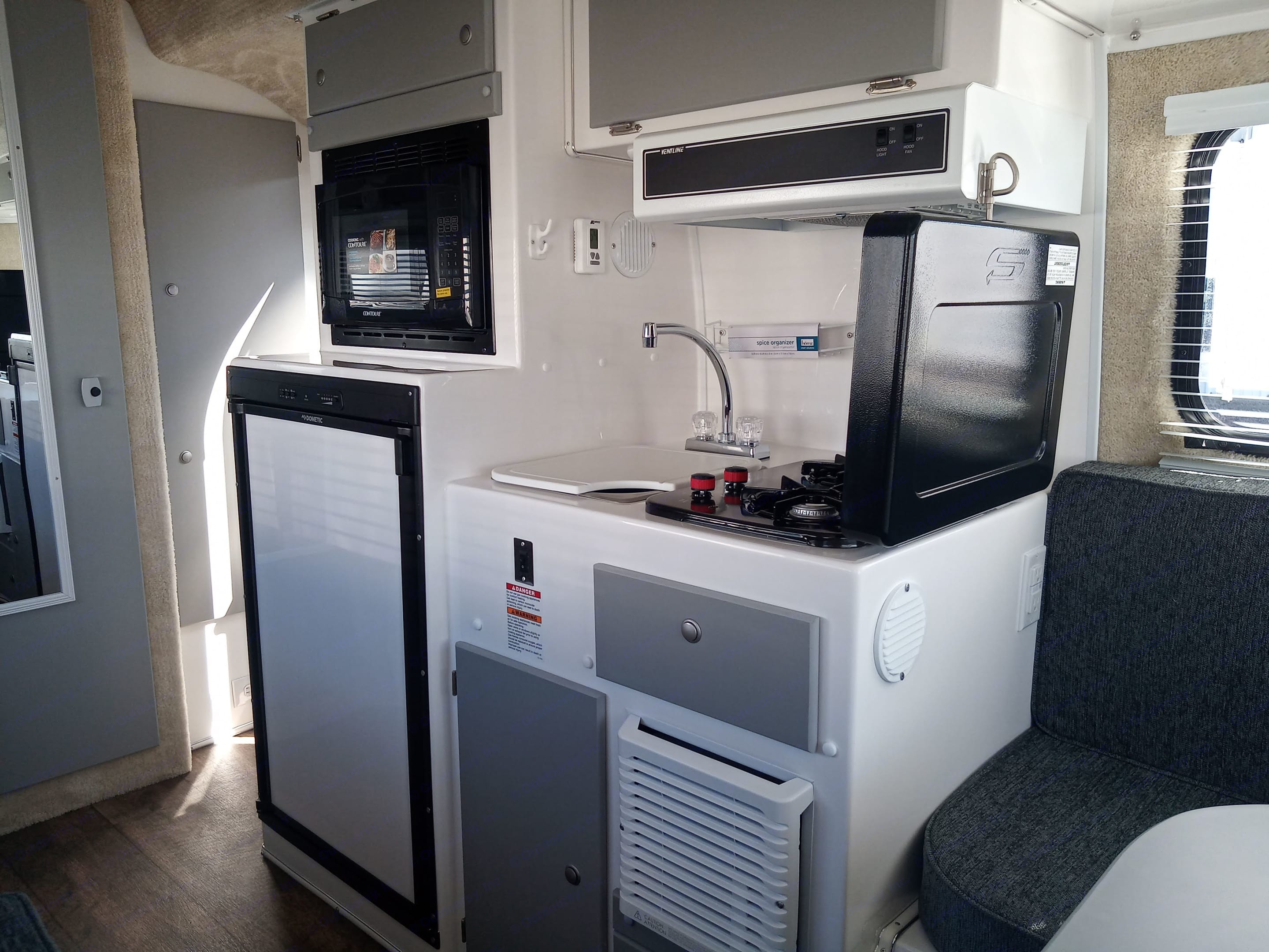 Refrigerator, microwave, sink and stove. Casita 17' Spirit Deluxe 2020