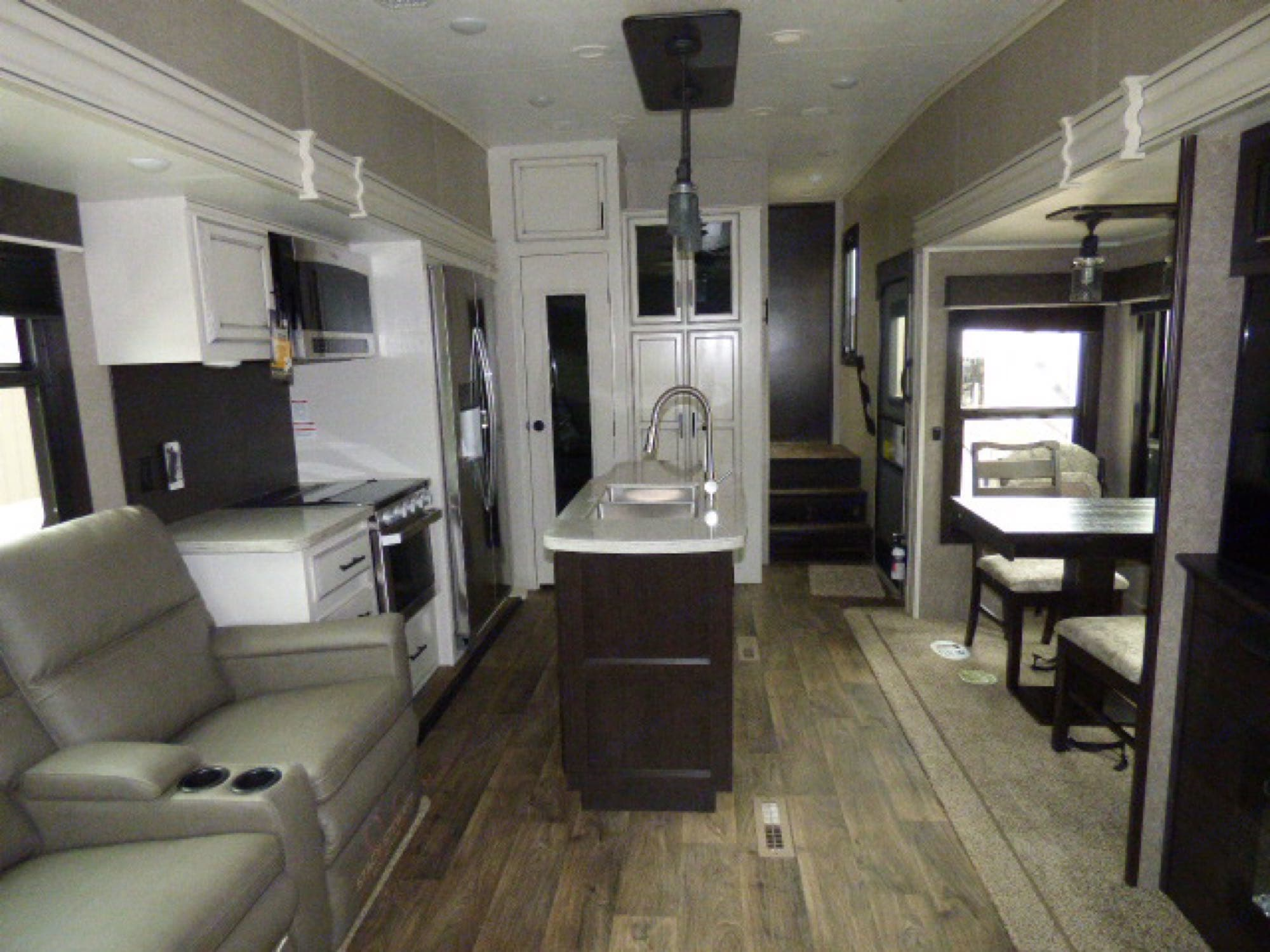 Modern white and gray interior with kitchen island.. Jayco Eagle 2020