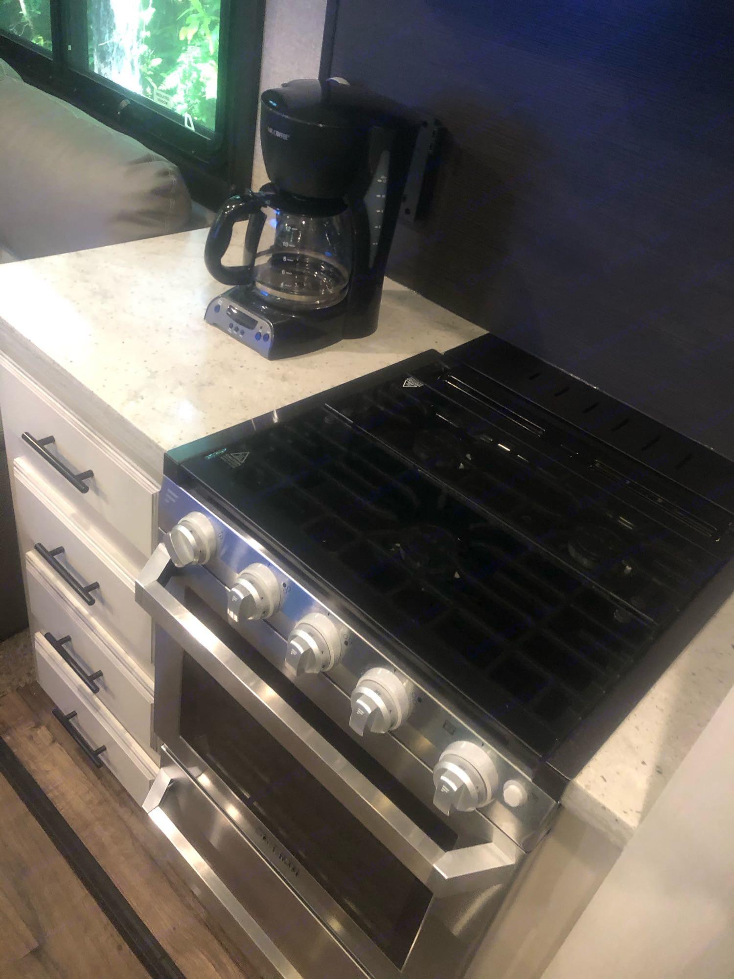 3 burner stove oven combo. Standard coffee pot. Jayco Eagle 2020