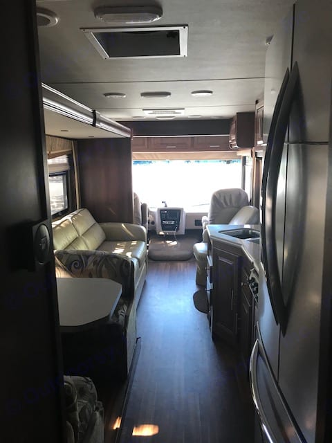 Motorhome with slides in taken from the middle. Forest River Georgetown 2015