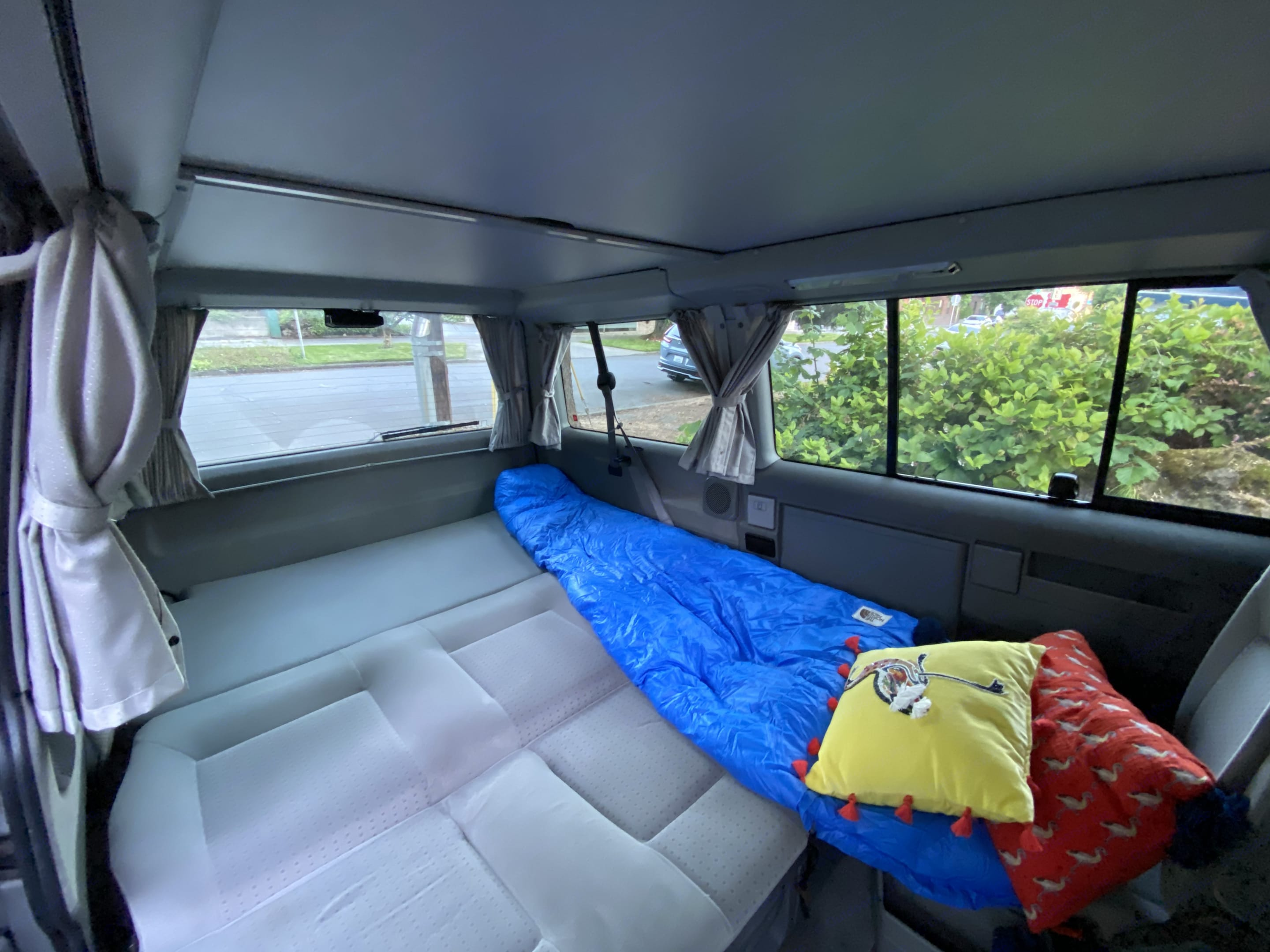 The backseat folds down and makes into a full-size bed that sleeps two. . Volkswagen Westfalia Eurovan Weekender 2002