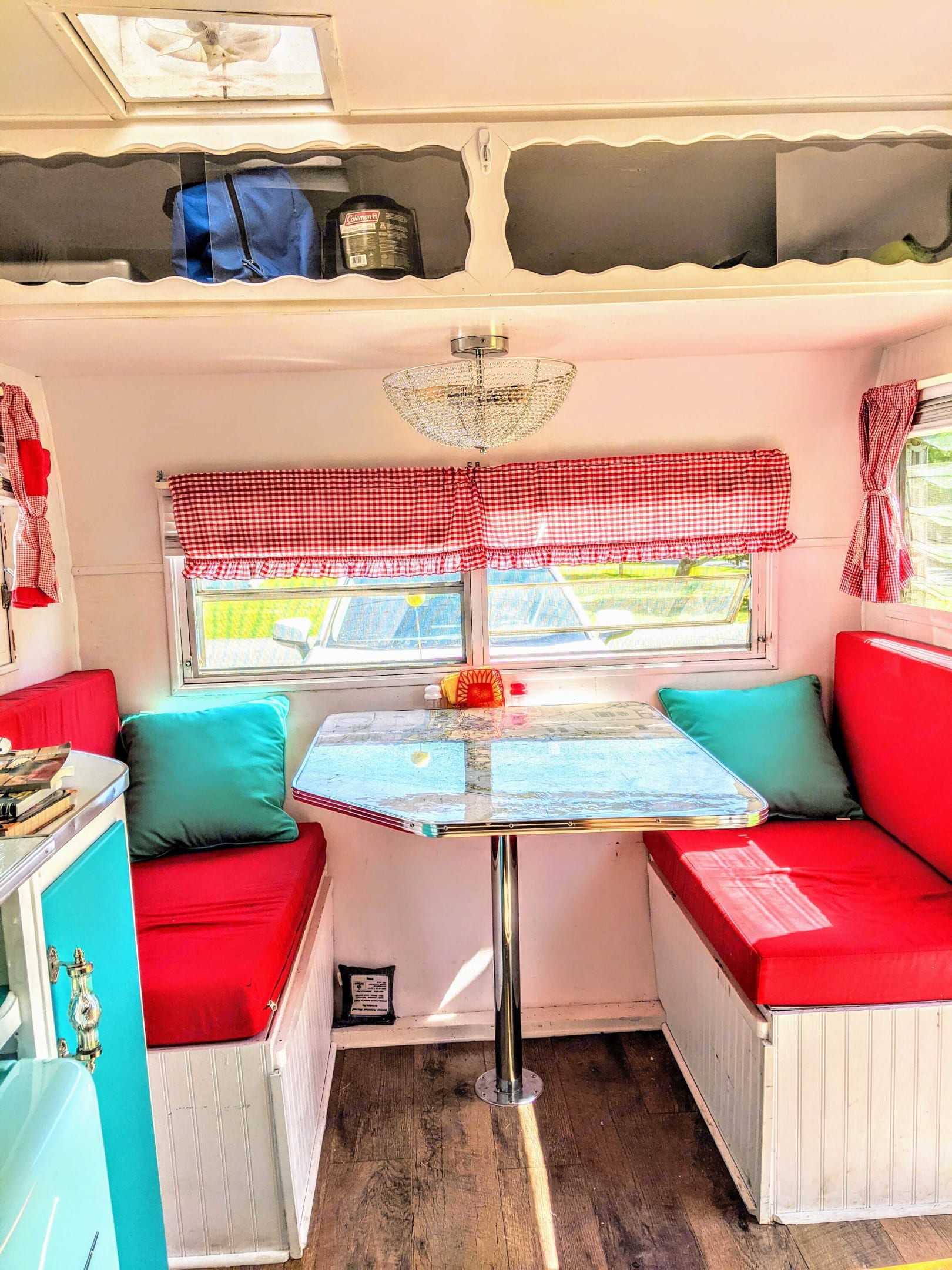 Dinette Seating area with comfy cushions. Shasta Custom 1960