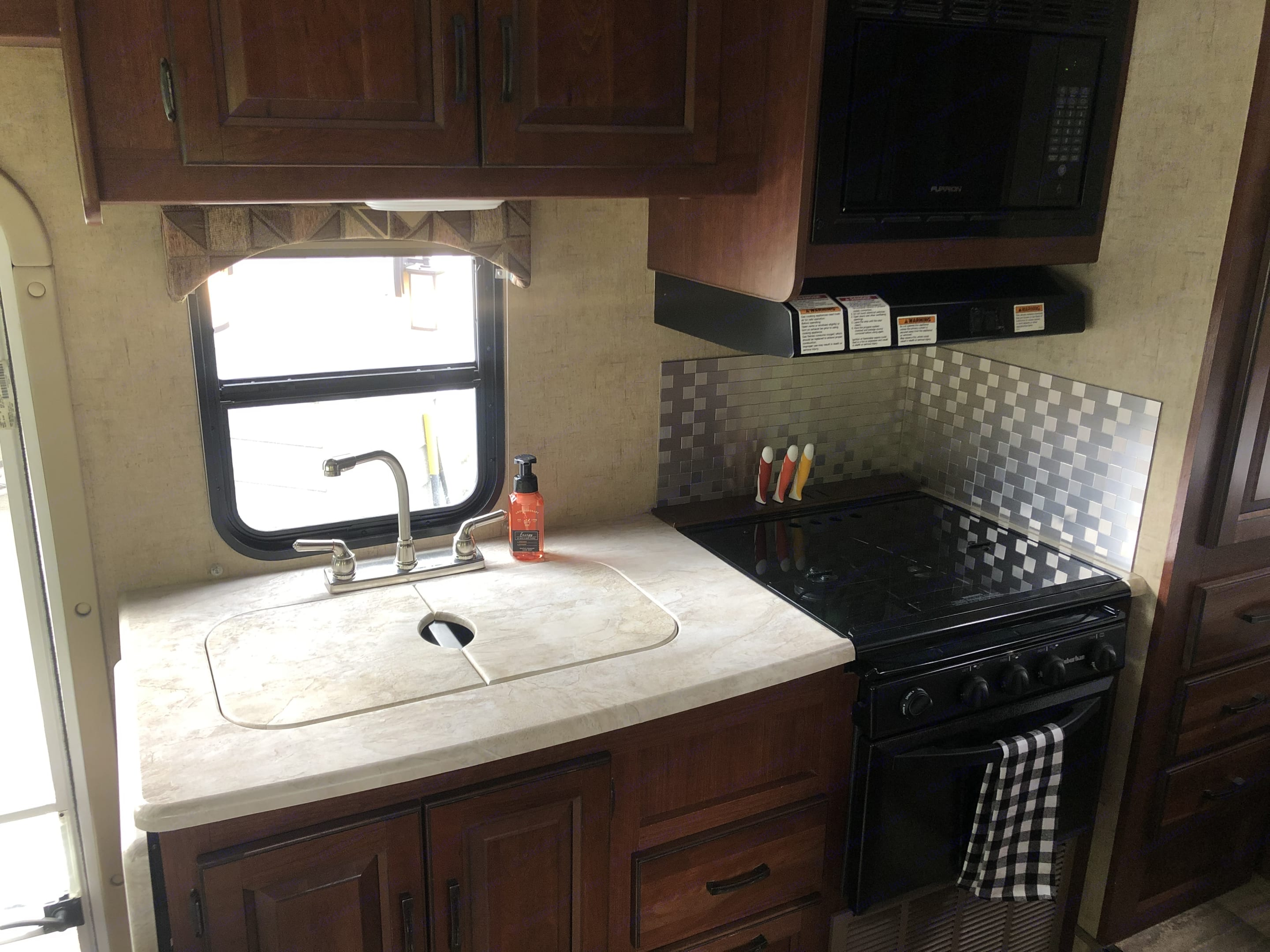 Kitchen area - fully stocked. Forest River Sunseeker 2016