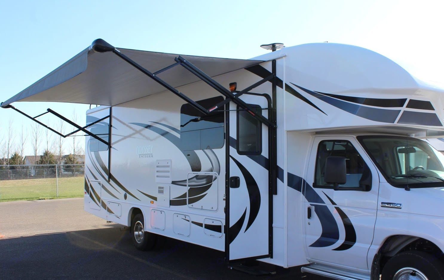 Passenger side with awning open.. Entegra Coach Odyssey 31 F 2020