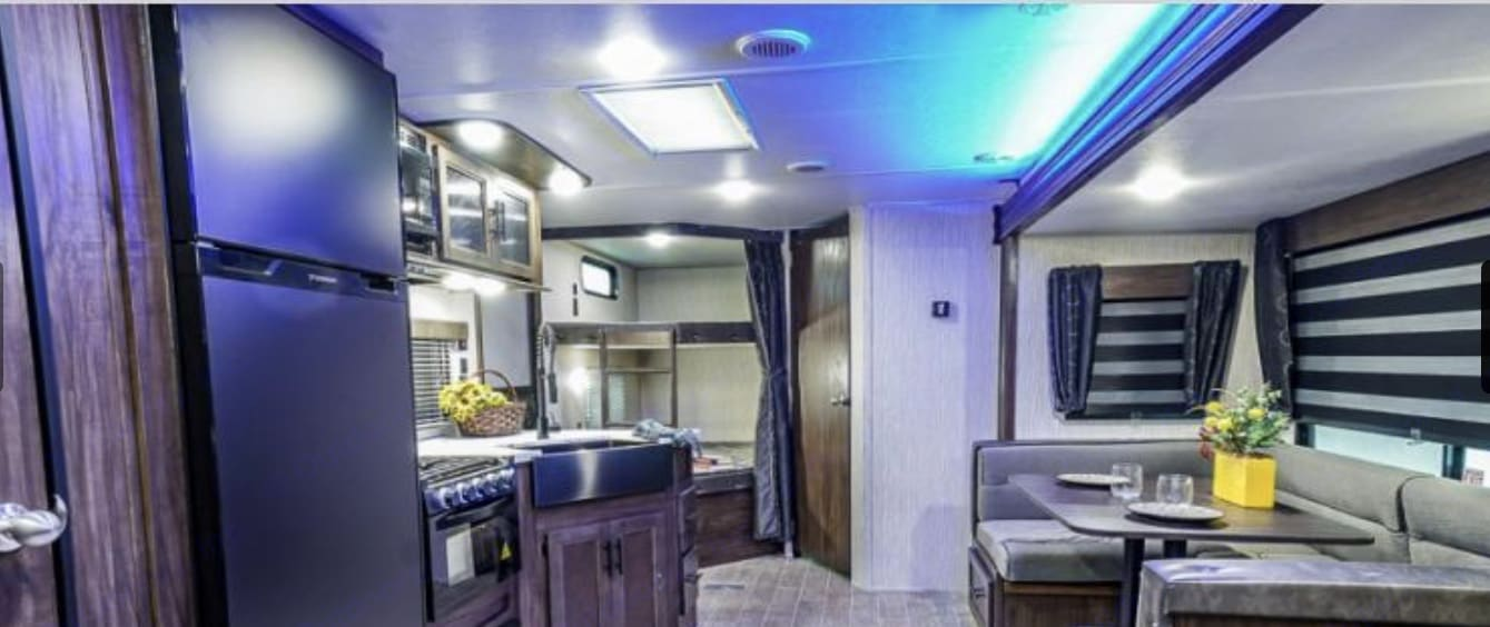 View from front of travel trailer coming out of master bedroom.. Forest River Cherokee Grey Wolf 264BDH 2020