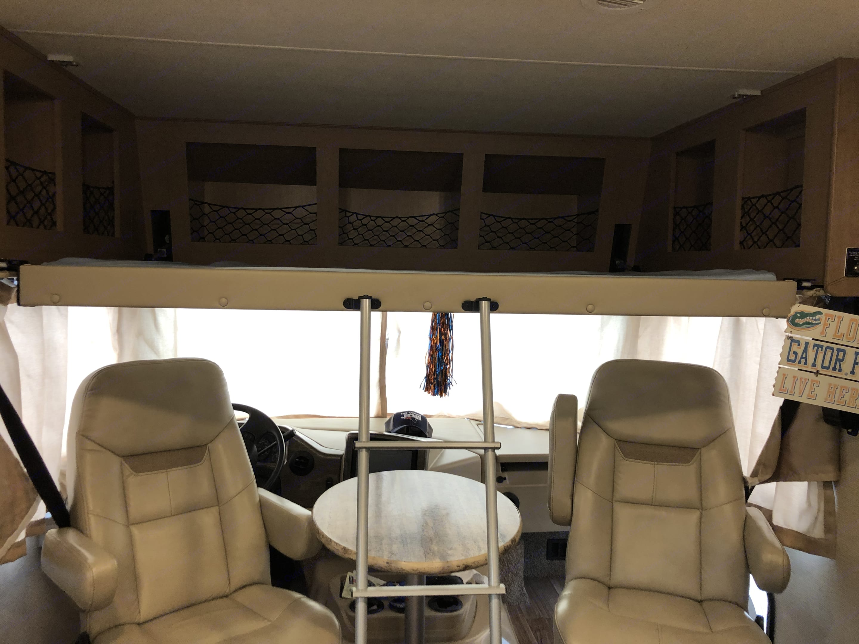 Bed above driver seats that raises or lowers. Thor Motor Coach A.C.E 2019