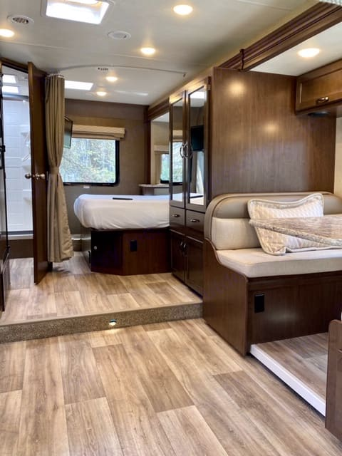 Living area with slide out bedroom in rear. Thor Motor Coach Freedom Elite 2019