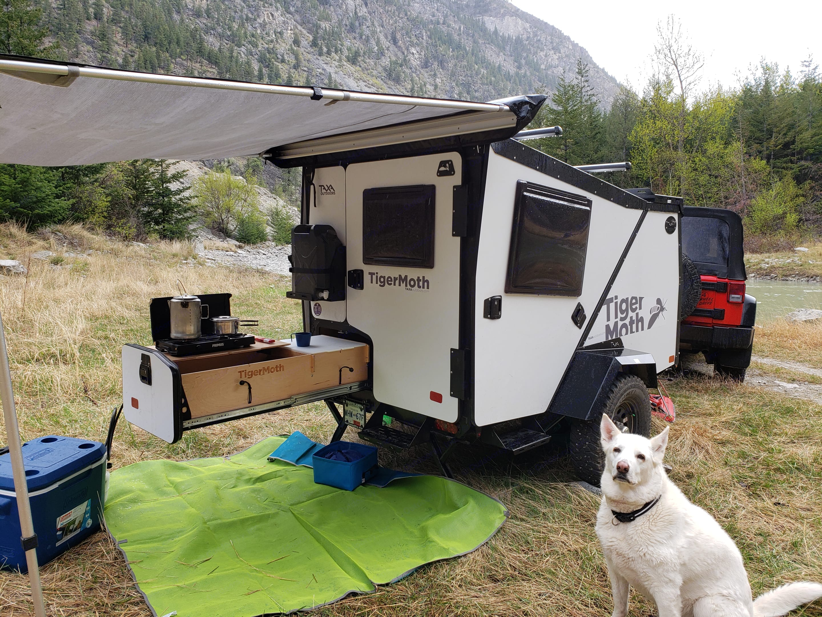 A stove, sink, water and storage.  Super easy to setup and put away.. TAXA Outdoors Tigermoth Camper 2020