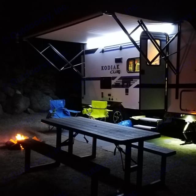 Big awning with lights allows you to enjoy the night even if it does rain a little.. Kodiak Cub 2018