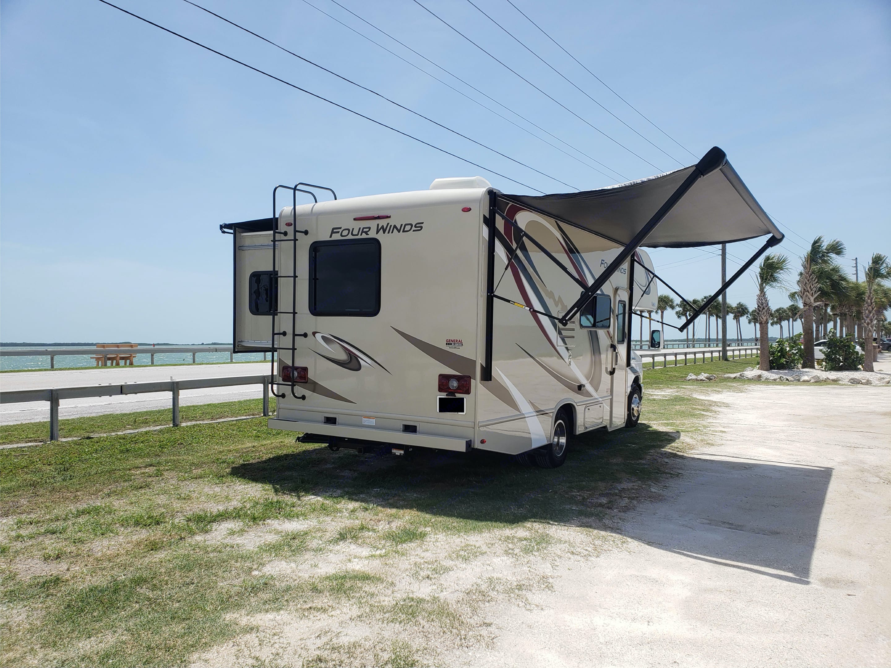 Rear View With Extended Awning.. Thor Motor Coach Four Winds 2020