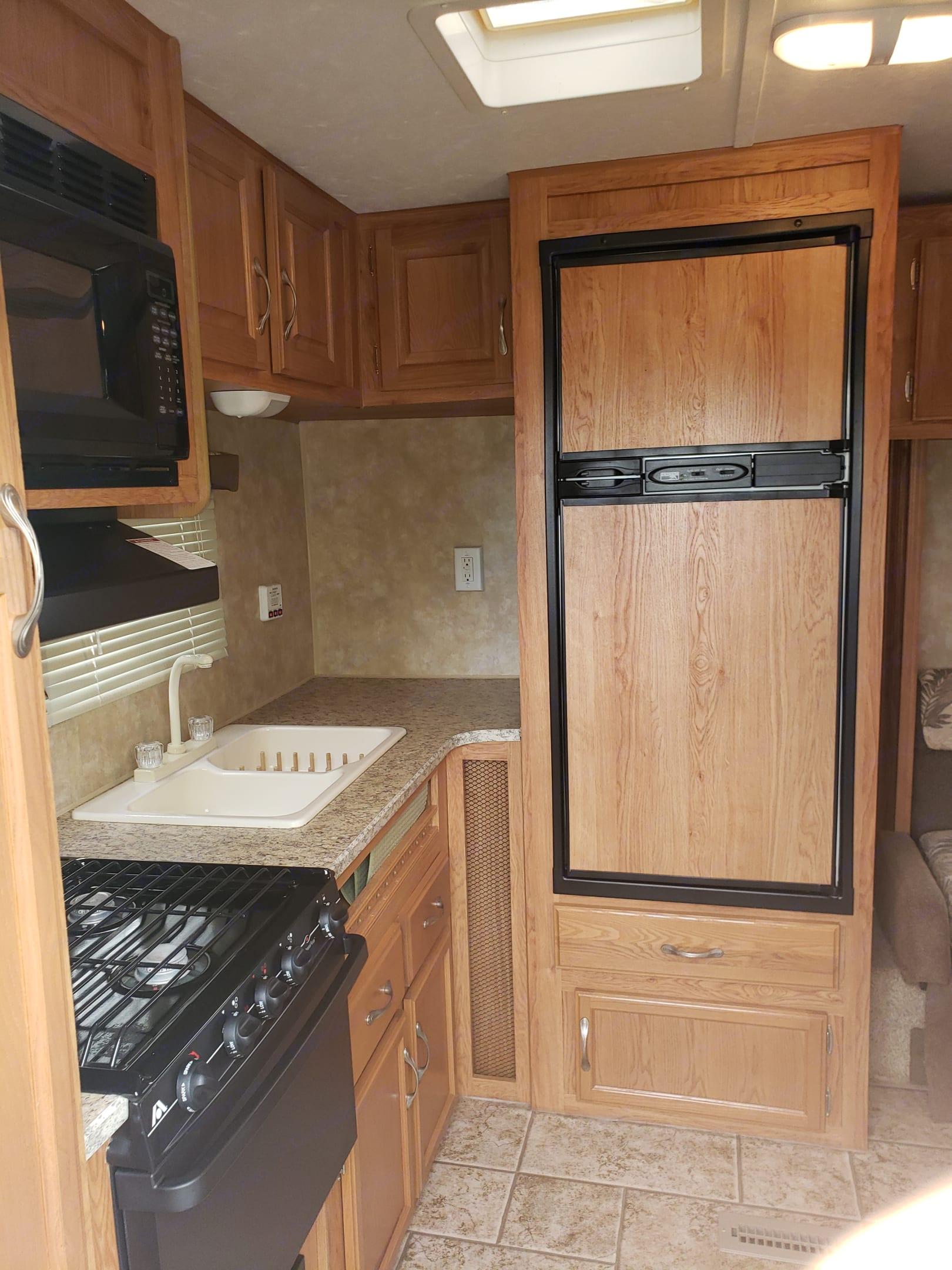 The large fridge and sink. Jayco Jay Flight 2009