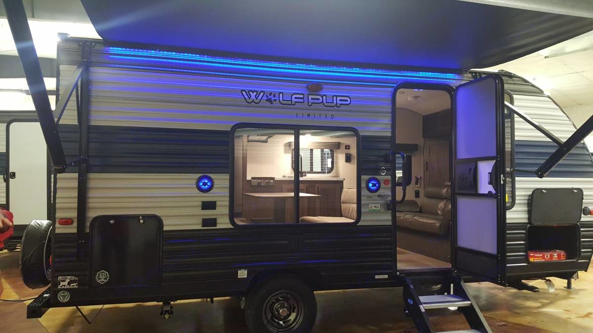 Lights and outdoor speakers below the electric awning- a perfect place to spend an evening.. Forest River Wolf Pup 2021