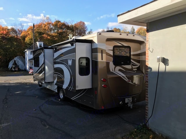 Rear in driveway; garage 30 amp hook up. Winnebago Aspect 2012