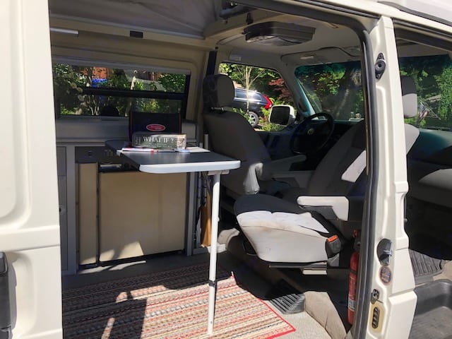 Front chair swivels for additional seating.. Volkswagen Eurovan Camper 2000